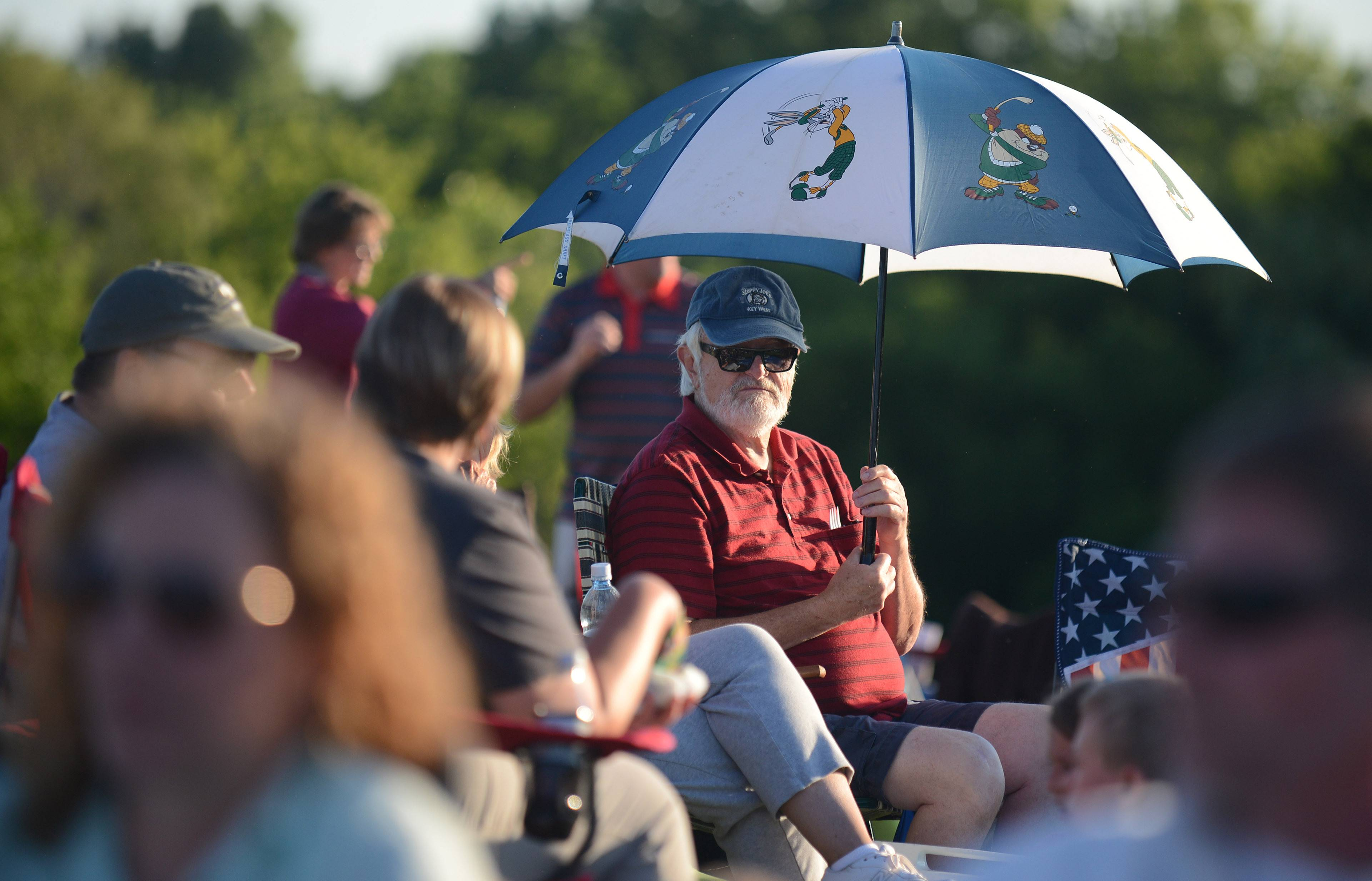 Frank Ahern of Niles waits for the concert and fireworks to start Thursday at the Cary Summer Celebration at Lions Park. Ahern came with Kay Cooms of Palatine and her daughter, Amy Arnieri of Cary.