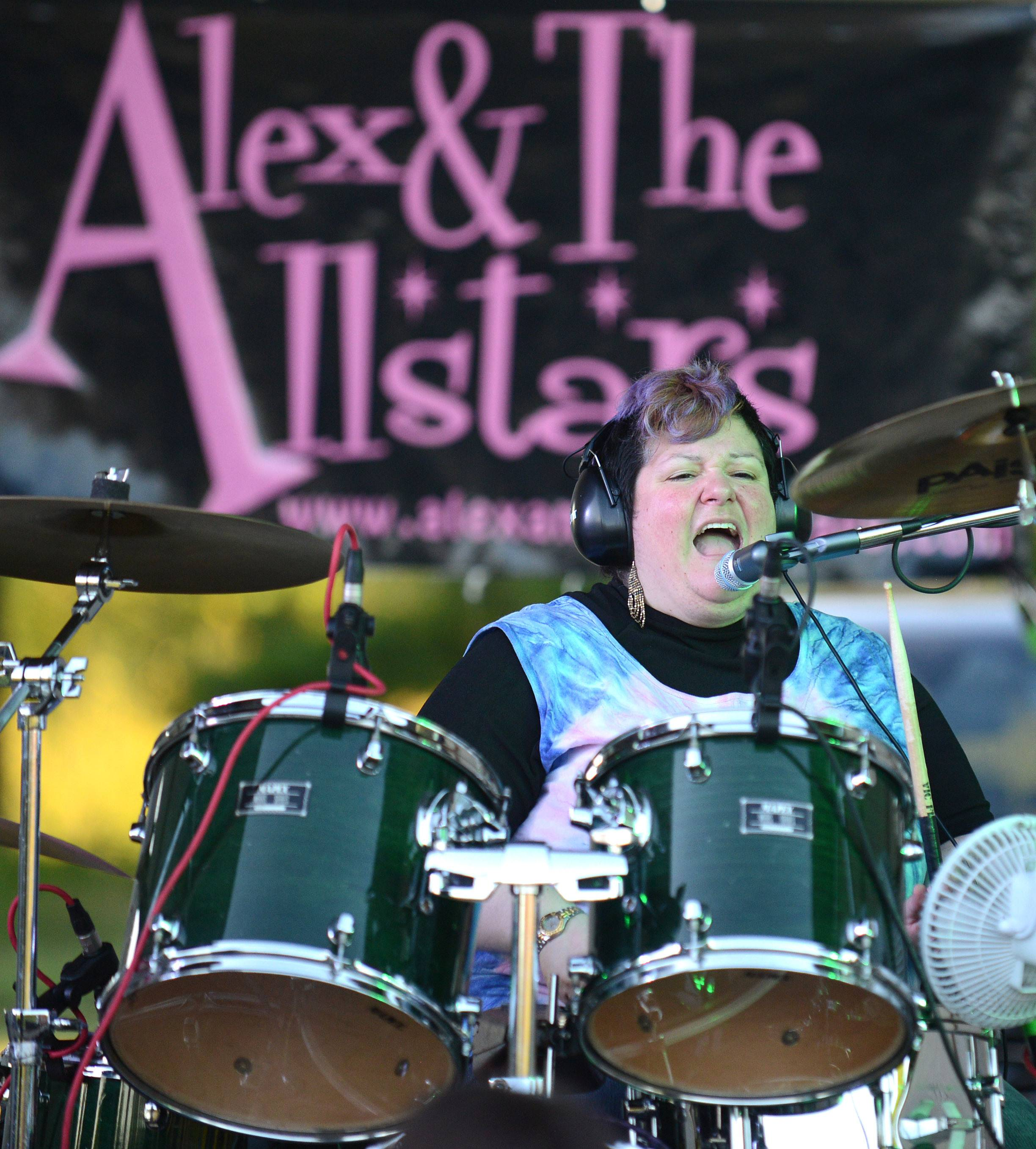 Alex Stanco of Fox River Grove is on lead vocals and drums for the Alex and The Allstars band while they play at the Cary Summer Celebration at Lions Park on Thursday, July 3. The band covers 70s and 80s music.