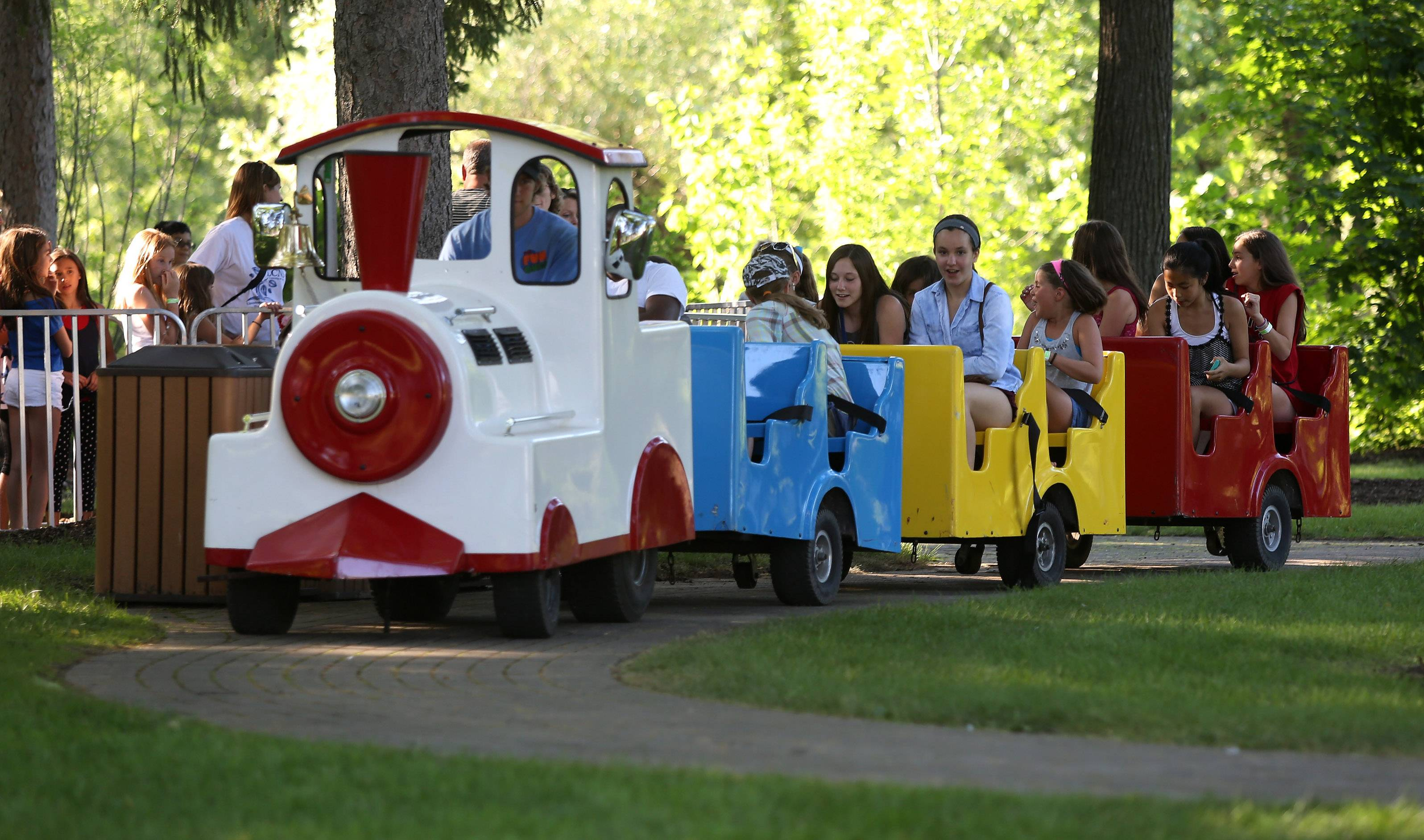 Engineer Jason Fekety drives the Choo Choo Express loaded with children and families during the first day of Lincolnshire's Red, White & Boom celebration Thursday at Spring Lake Park.