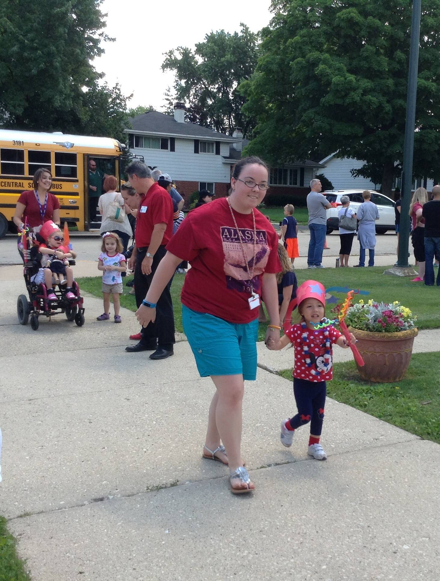 Teachers and students walk together in an early July 4 parade Thursday at Jefferson Middle School in Wheaton.