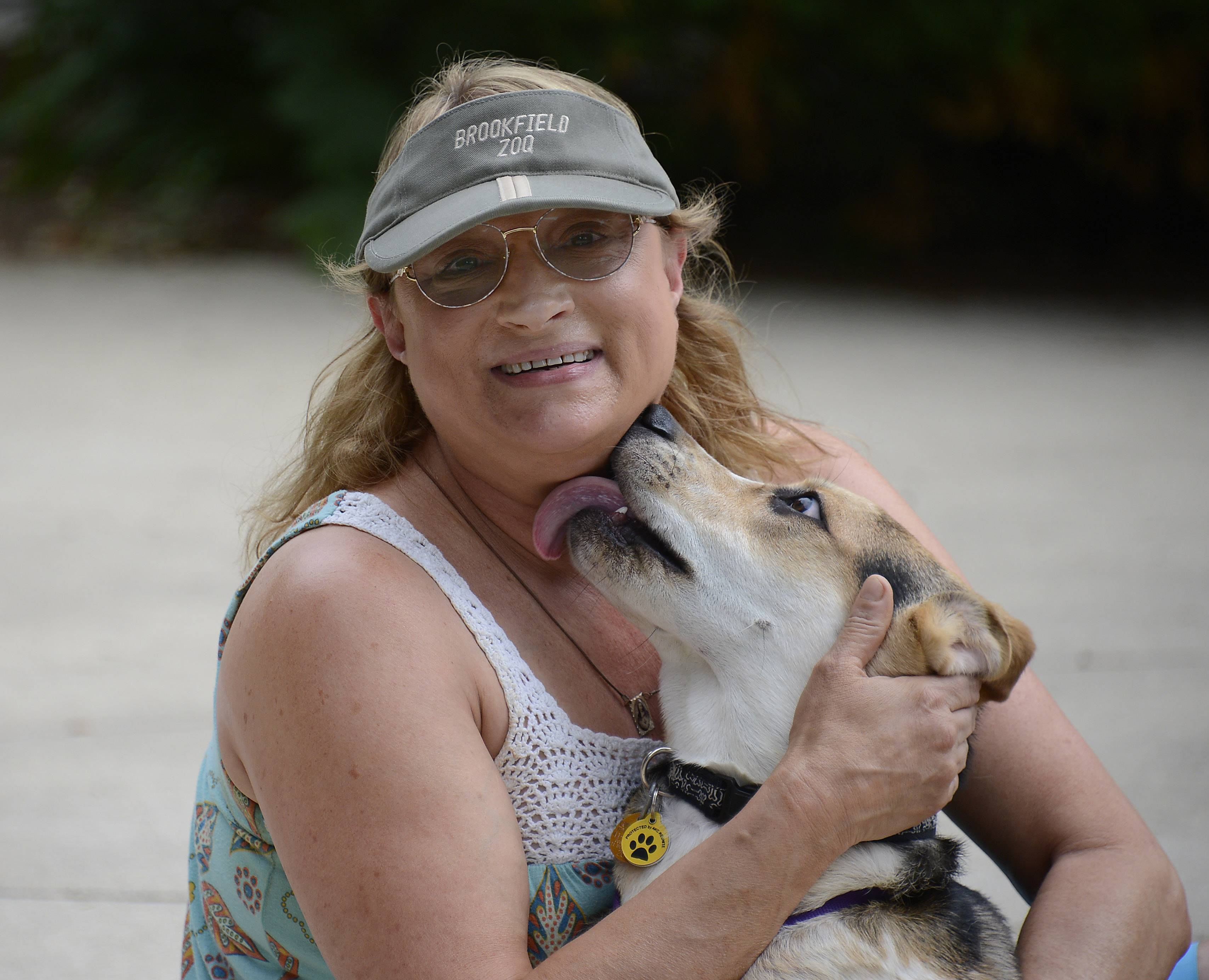 Wendi Cali and her dog Rango during play time in Arlington Heights. She saved Rango and Rango saved her after her other dog died.