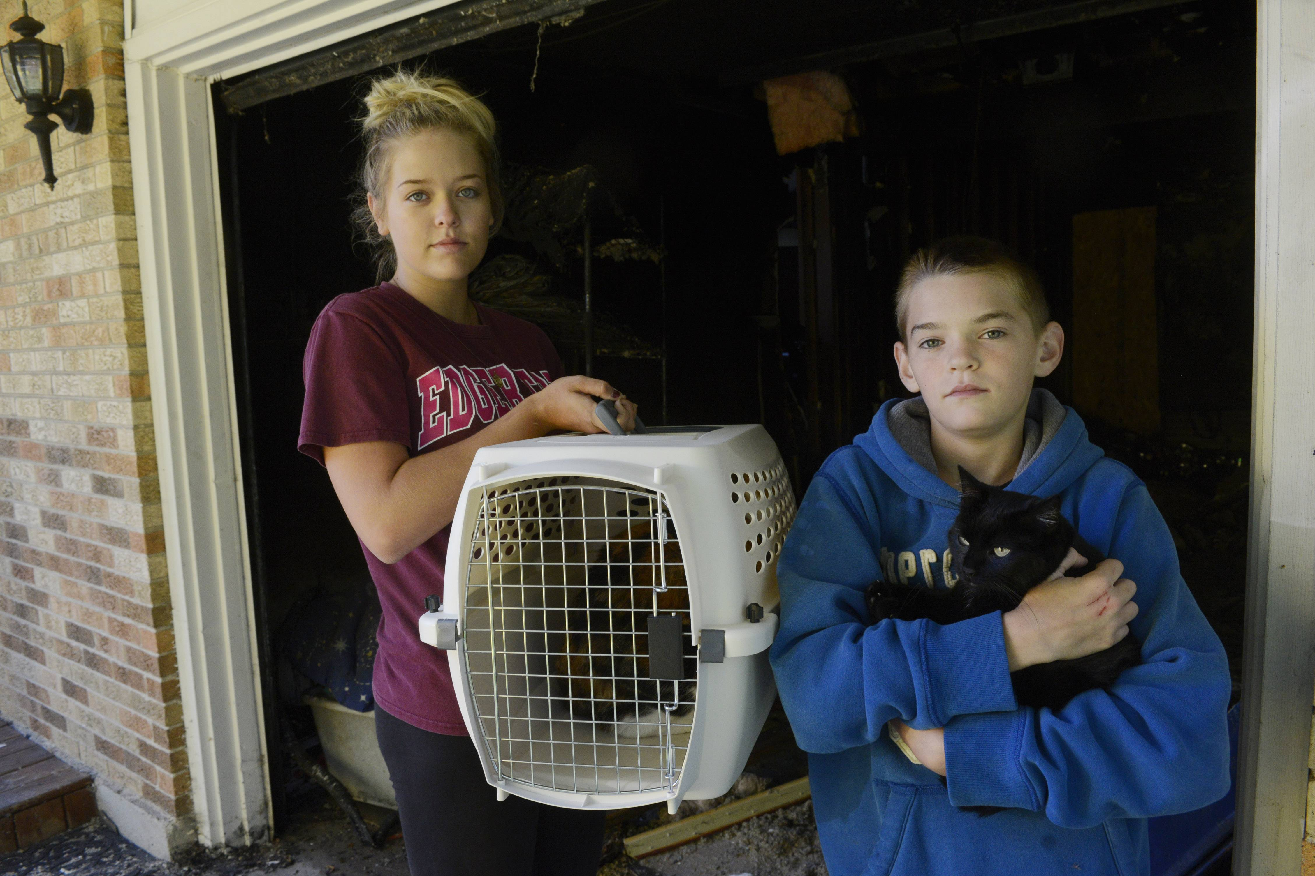Dominic Laskero, 13, right, was instrumental in getting his 19-year old sister, Jessica Lotesto, left, and his 77-year-old grandmother out of their burning Hoffman Estates house Sunday morning. He also got their dog out, and firefighters arrived quickly enough to recover and resuscitate two cats which had been trapped inside.