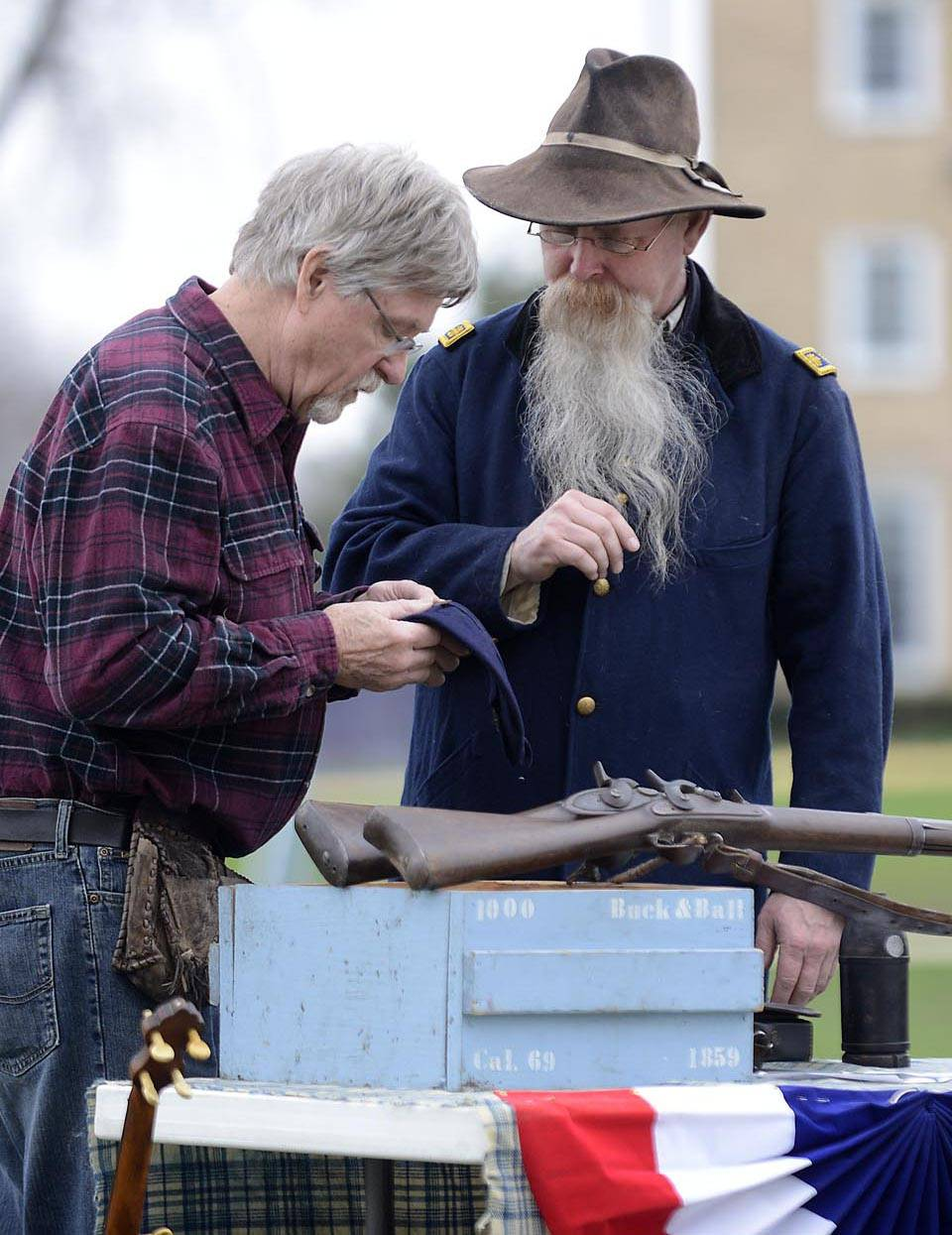Ken Gough, right, talks with a visitor about his Civil War guns at the ninth annual Elgin History Fair last summer at the Elgin History Museum.