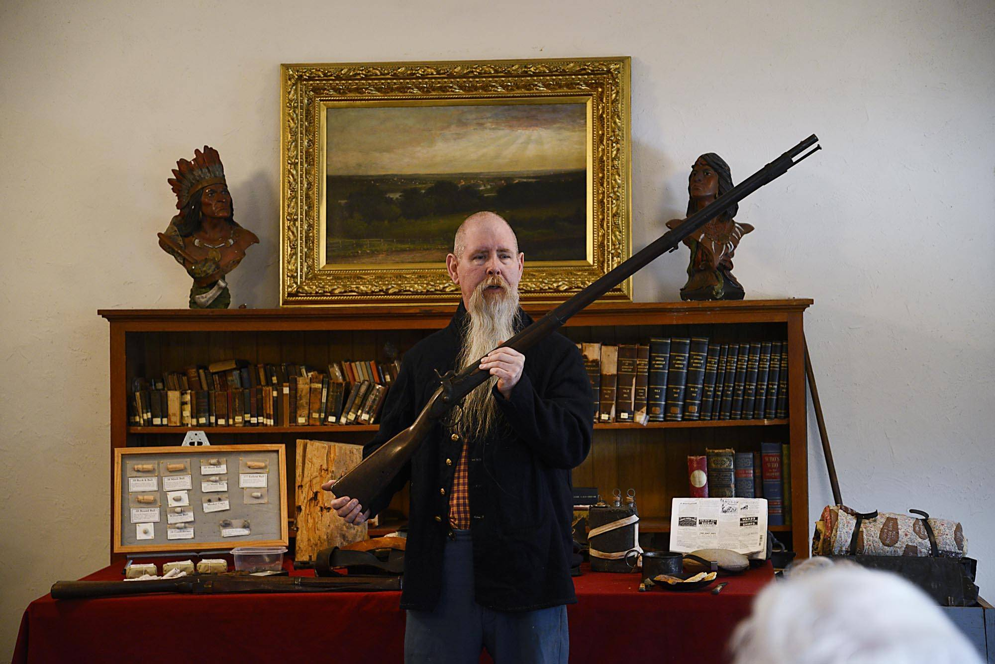 Civil War historian Ken Gough of Elgin holds an 1827 flintlock rifle he says he can trace to specific battles of the Civil War, during a recent presentation at the Dundee Township Historical Society in West Dundee. He spoke about the 52nd Regiment Illinois Volunteer Infantry.