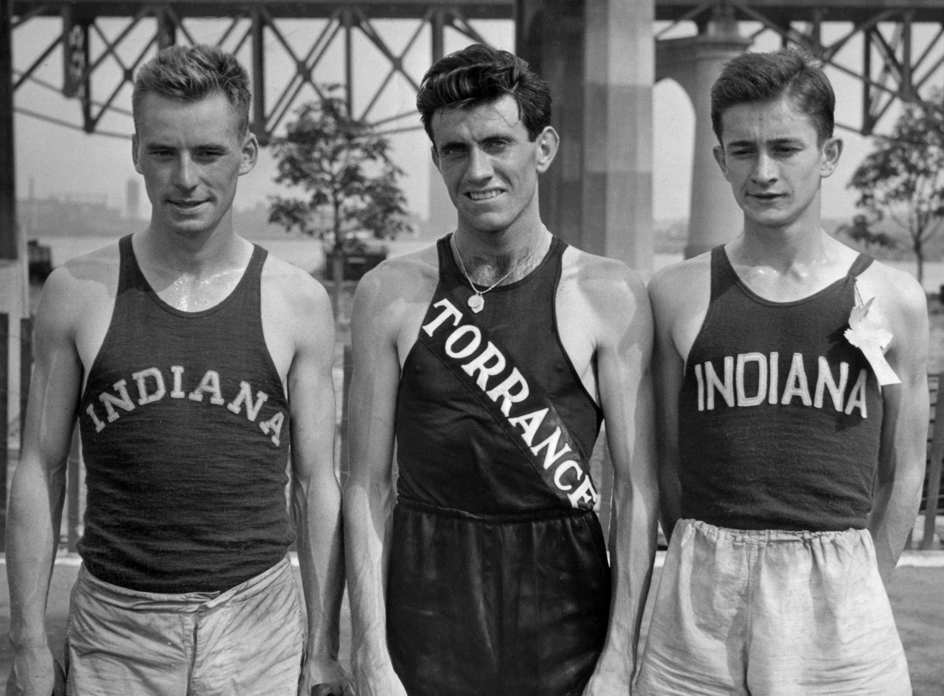 Don Lash of Indiana, left, Louis Zamperini of Los Angeles, center, and Thomas Deckard of Indiana, at the Olympic tryouts in New York in 1936. Zamperini, a U.S. Olympic distance runner and World War II veteran who survived 47 days on a raft in the Pacific after his bomber crashed, then endured two years in Japanese prison camps, died Wednesday, July 2, 2014. He was 97.
