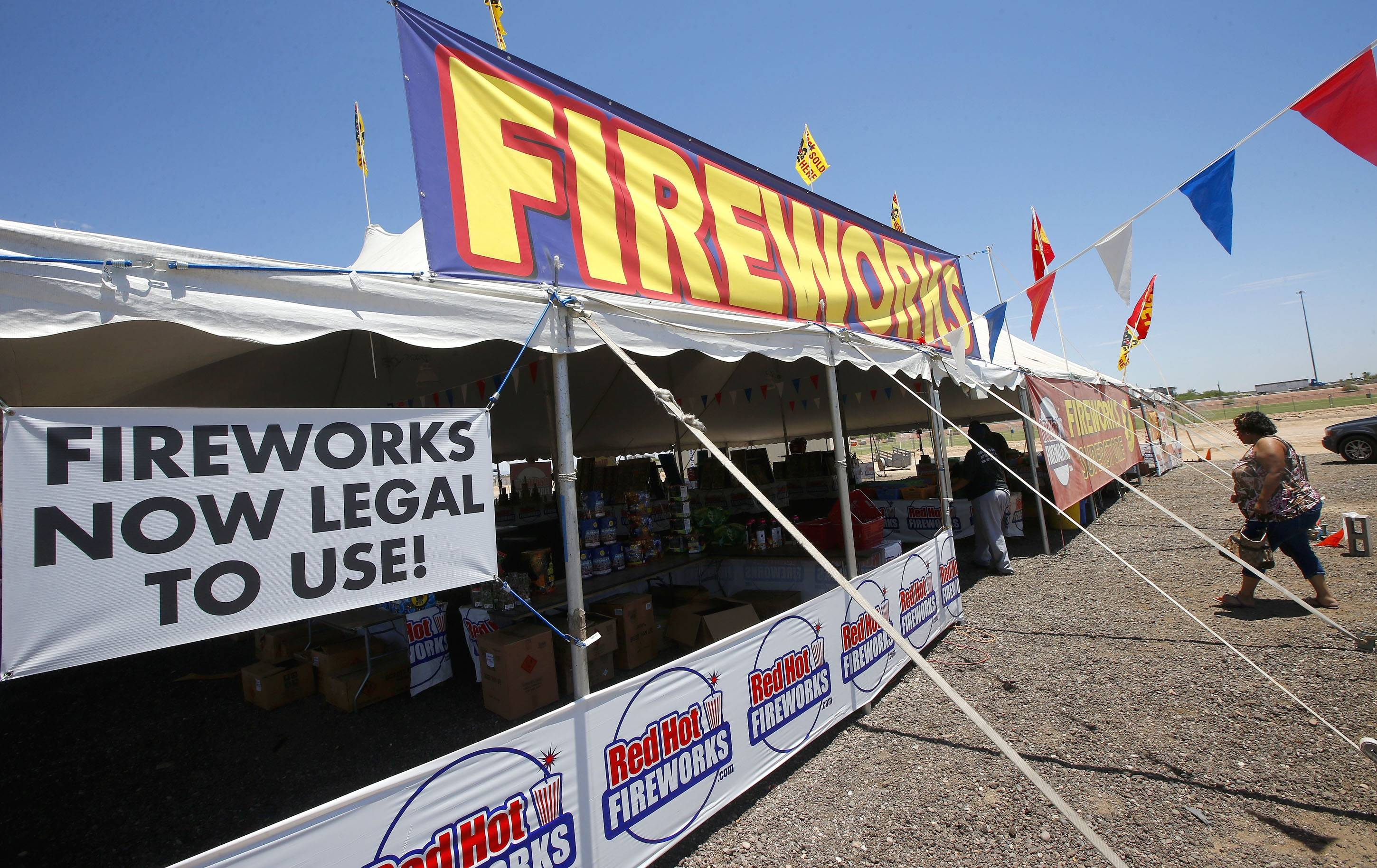 Customers walk into a Red Hot Fireworks tent Wednesday in Phoenix. Although Phoenix has gone a full 120 days without any measurable precipitation there has not been any serious effort in the drought-stricken states to restrict fireworks.  Arizona actually loosened its restrictions this year and allowed residents of the two most populated cities to set off fireworks around Independence Day.