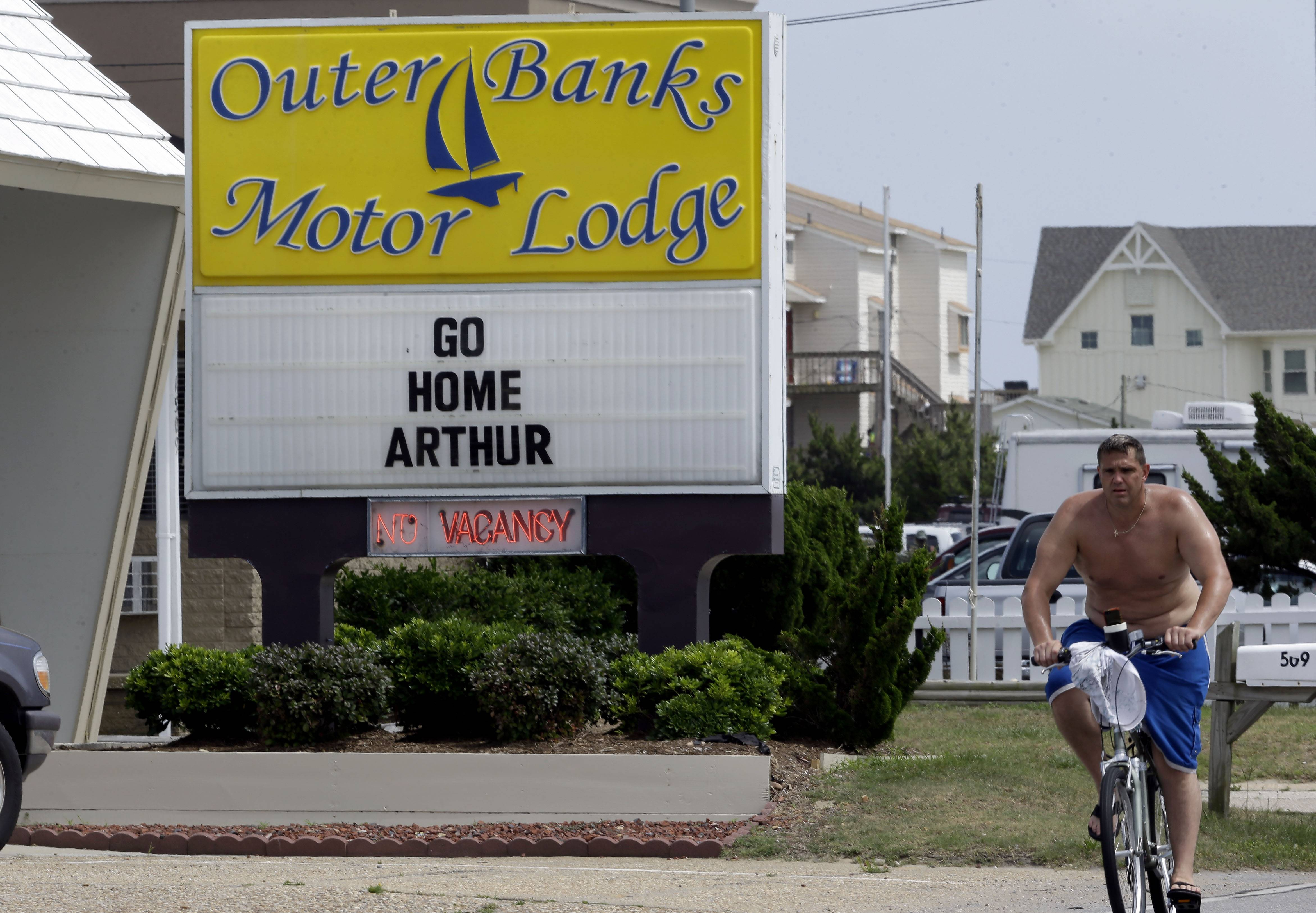 A sign at the Outer Banks Motor Lodge displays a message in Kill Devil Hills, N.C., Thursday. Hurricane Arthur is forecast to pass by Hatteras Island on Friday morning. The island is under mandatory evacuation orders.