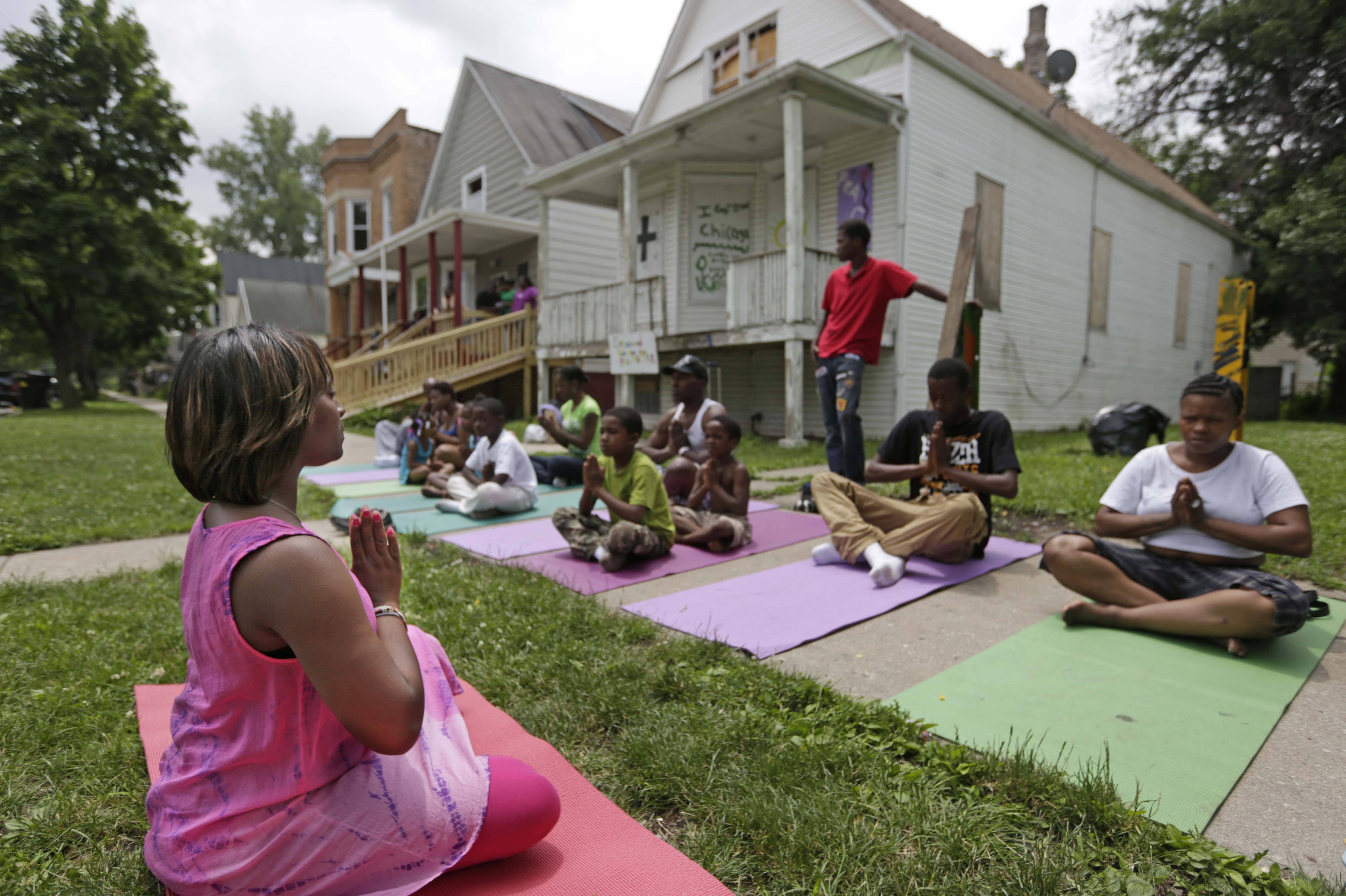 Tameka Lawson, executive director of a local non-profit group called 'I Grow Chicago' leads a yoga class along the often violent streets of Chicago's Englewood neighborhood. Lawson said yoga's meditative focus could help cooler heads prevail the next time violence or vengeance looms.