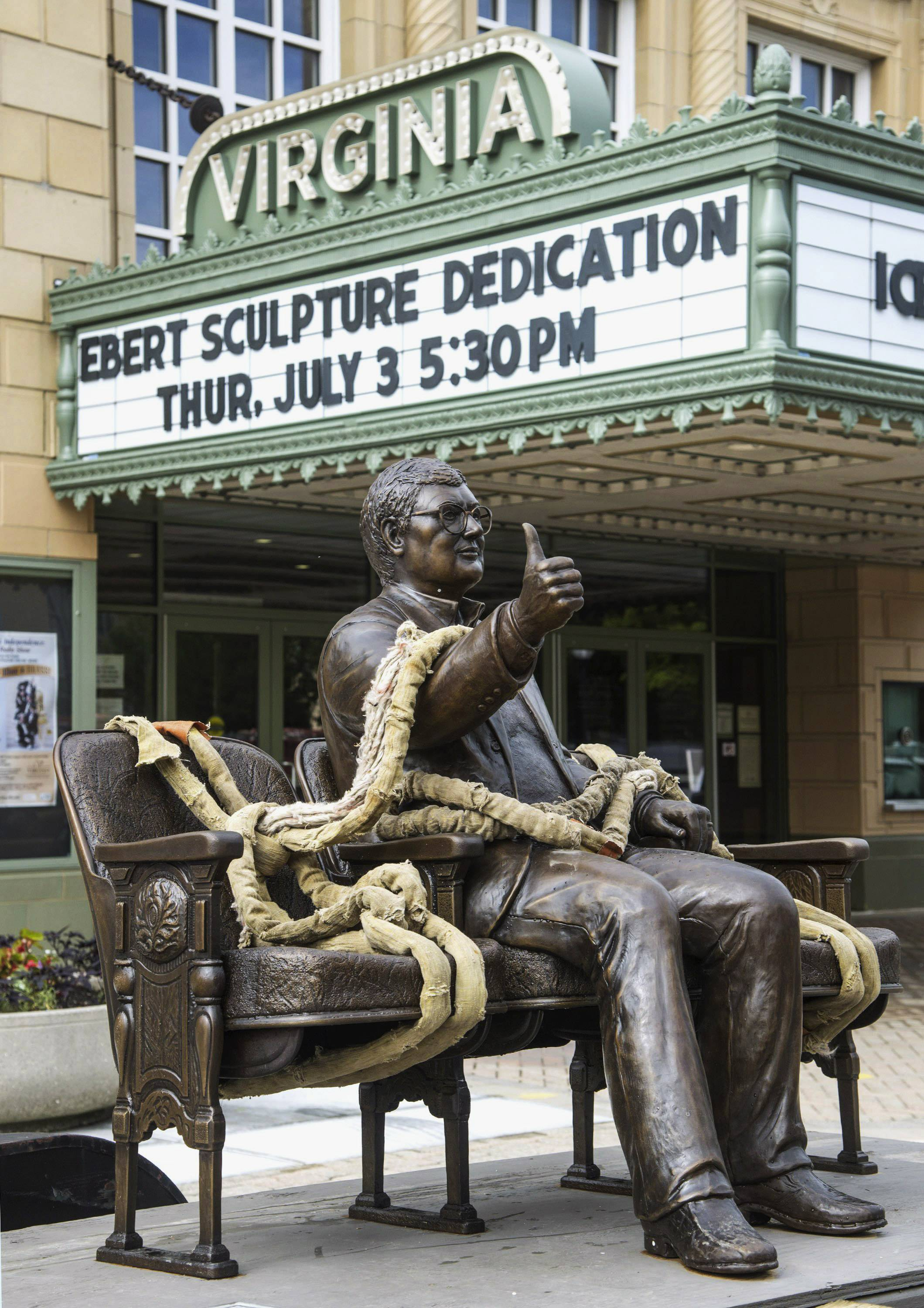 A statue of famed film critic Roger Ebert sits on a trailer awaiting installation Tuesday outside the Virginia Theatre in Champaign, Ill.