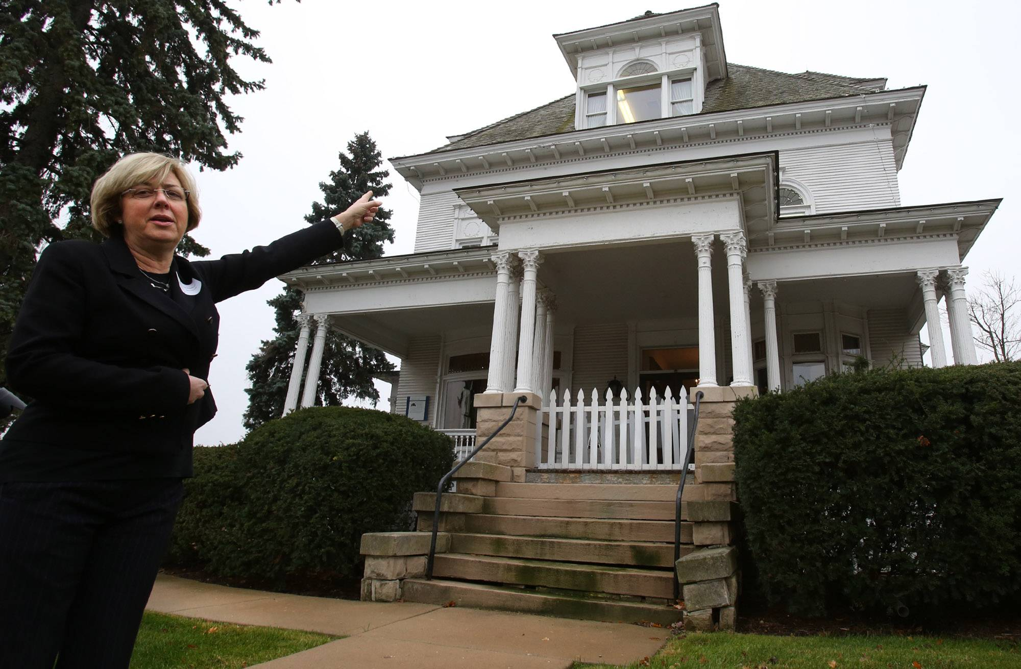 Beth Raseman, the Barrington White House project coordinator, discusses details of the exterior of the house during a community open house at Barrington�s White House last November.