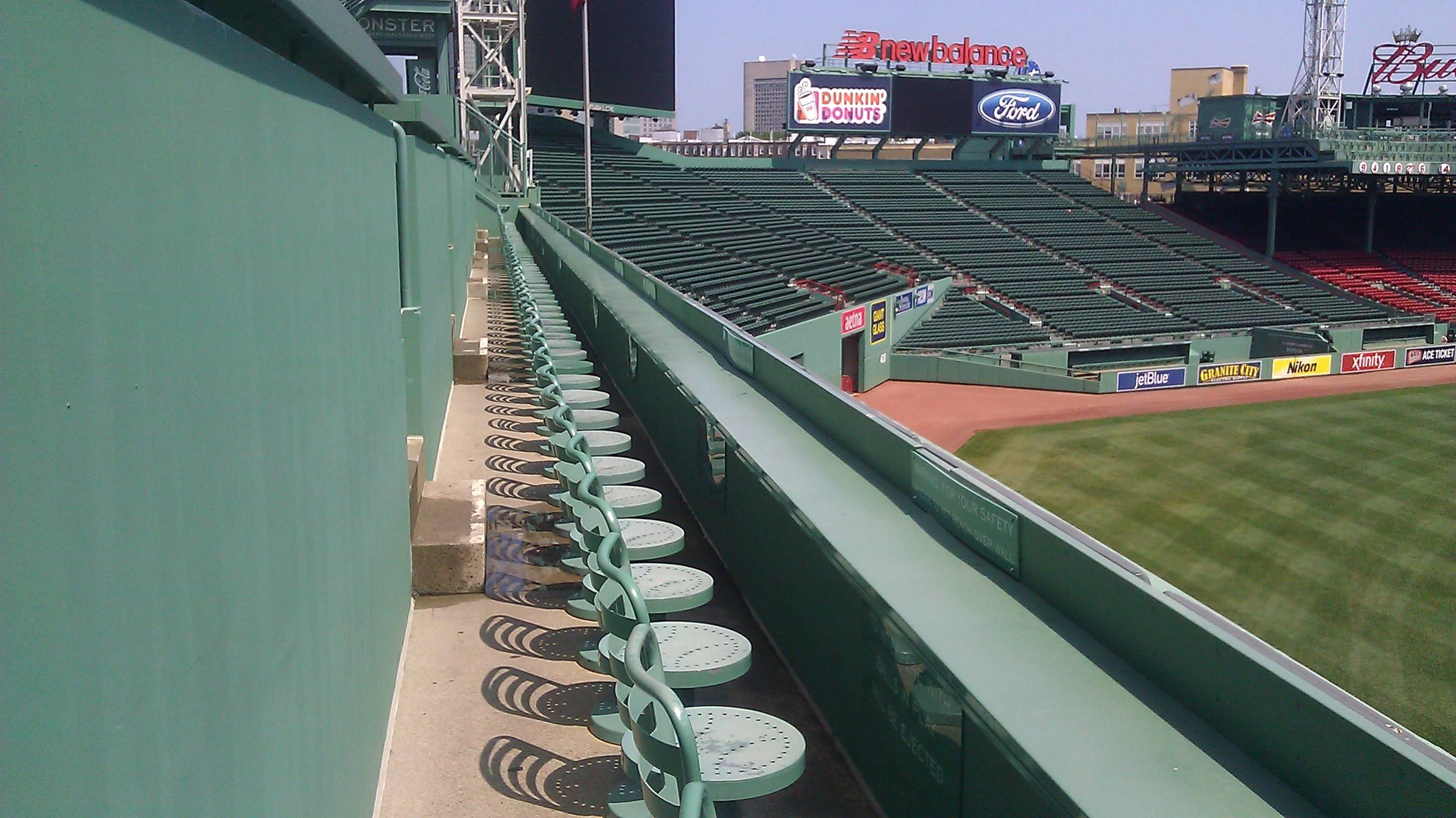 "When the Red Sox renovated Fenway Park, they added seating above the ""Green Monster"" wall in left field. It has generated more revenue for the club and become a popular spot."