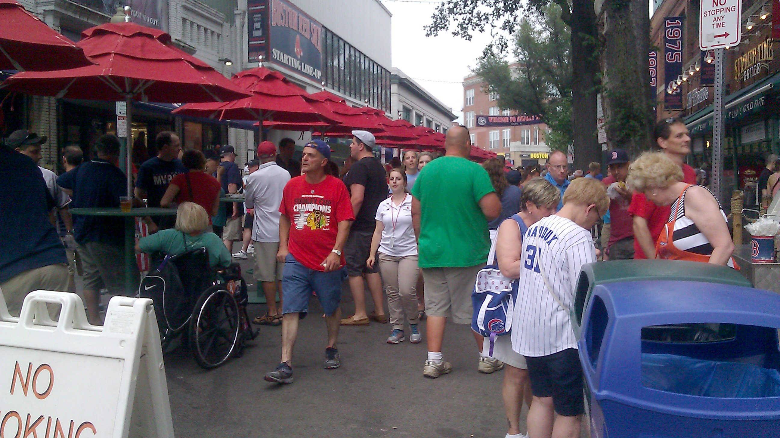 Yawkey Way, a street that runs along Fenway Park in Boston, is closed off on game days so Red Sox fans and enjoy the atmosphere outside the ballpark.
