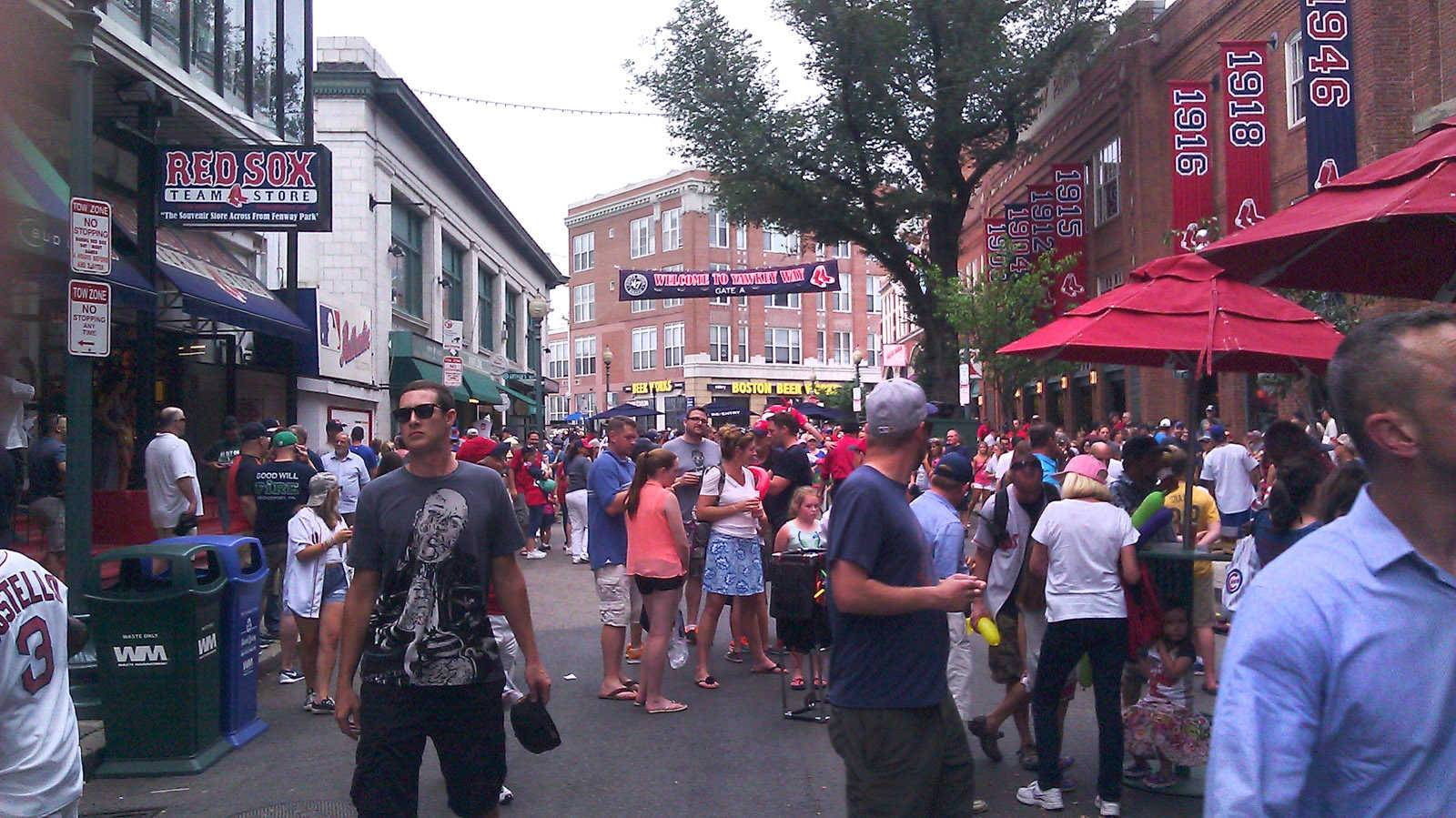 Yawkey Way is a busy spot on game days in Boston as Red Sox fans gather there before and after games.