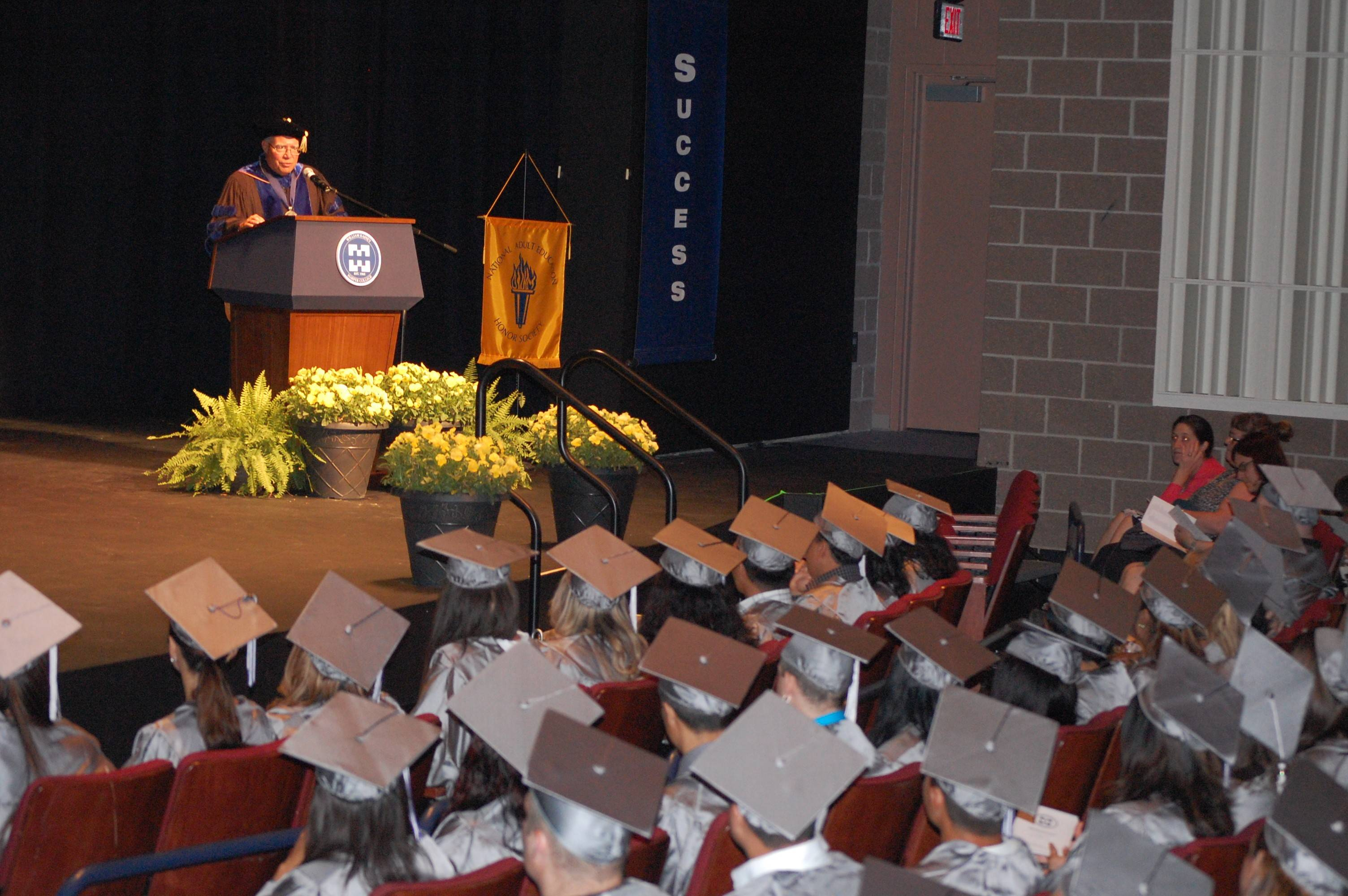 Harper College President Kenneth Ender speaks to the crowd at the college's GED graduation ceremony.