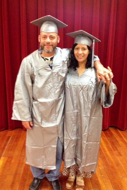 Husband and wife graduates David and Iris Rivera of Hoffman Estates at the Harper College GED graduation ceremony June 20.