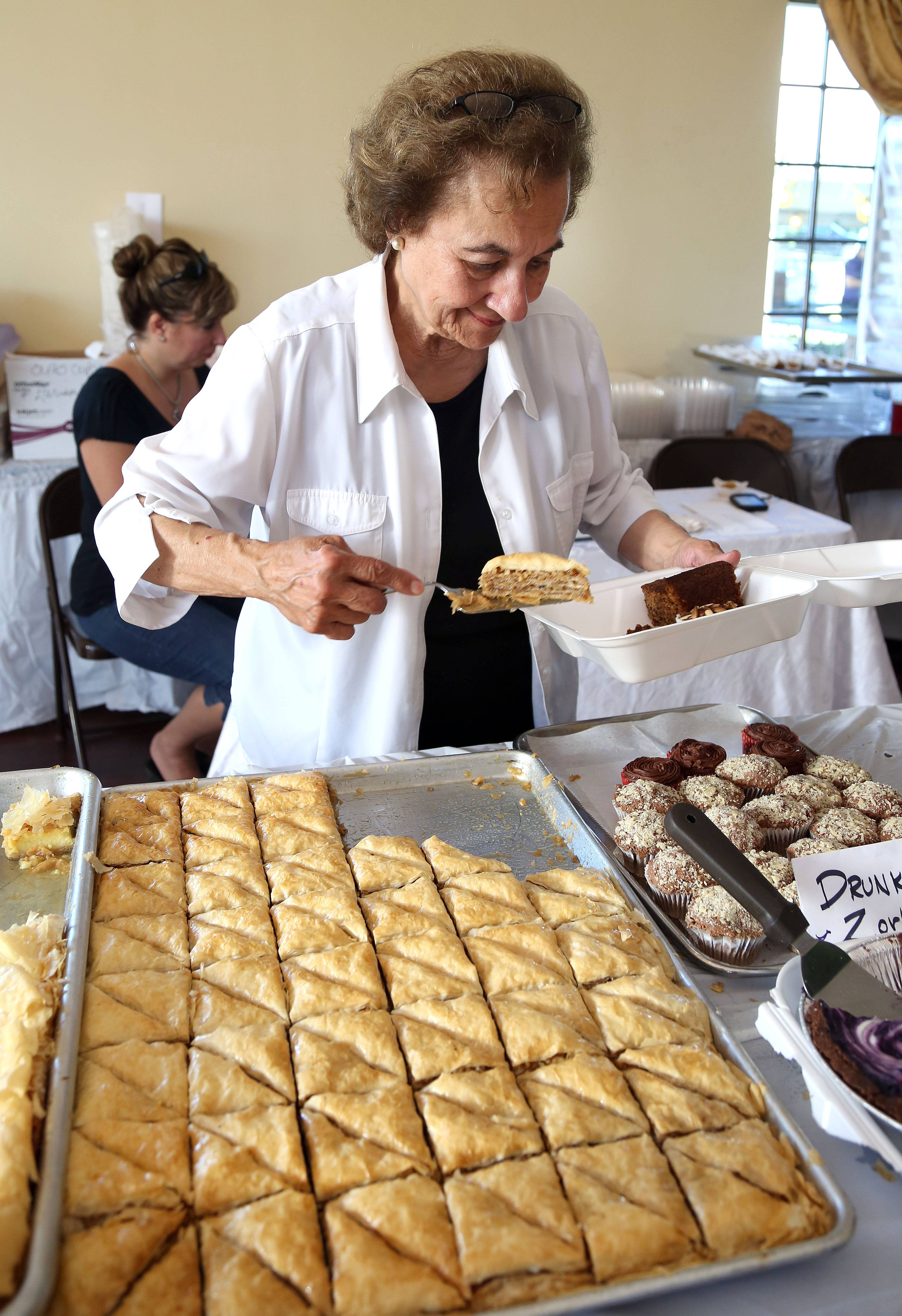 Mary Katris of Waukegan serves up some baklava during last year's Greek Fest at St. Demetrios.