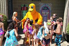 Kids party with one of the costumed characters at last year's Aquatics Week events at Bock Pool.Schaumburg Park District