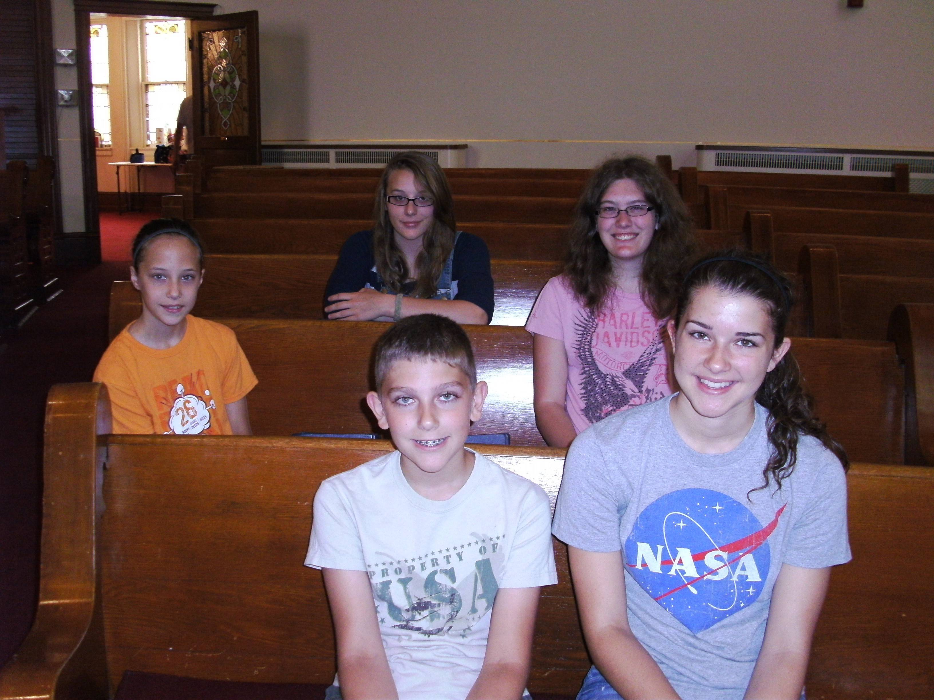 "A Hampshire team of five youth and two adults recently participated in a ""Stay"" Mission Trip, sponsored by Marengo United Methodist Church. Pictured are: first row, from left, Steven and Katelyn Schoedl, and back row, Mia Vonic, and Hailee and Melissa Dietze."