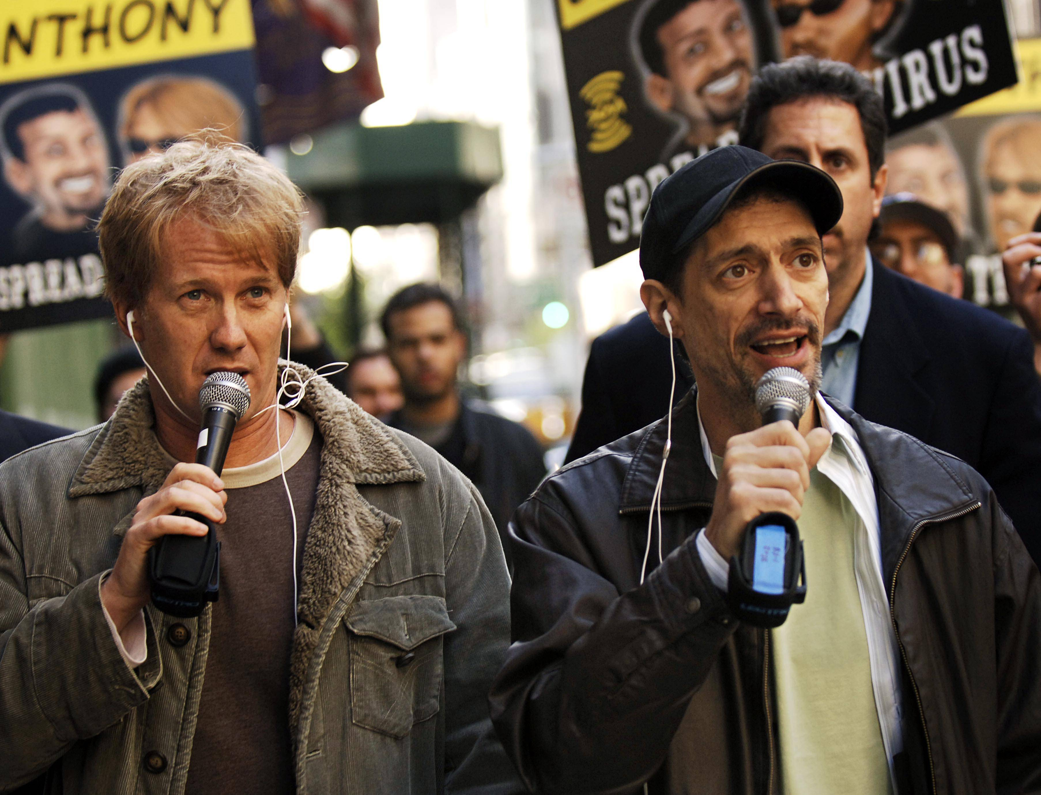 "Radio shock jocks Greg ""Opie"" Hughes, left, and Anthony Cumia, right, leave CBS Radio studios on 57th Street with fans after finishing their first morning show, in New York."
