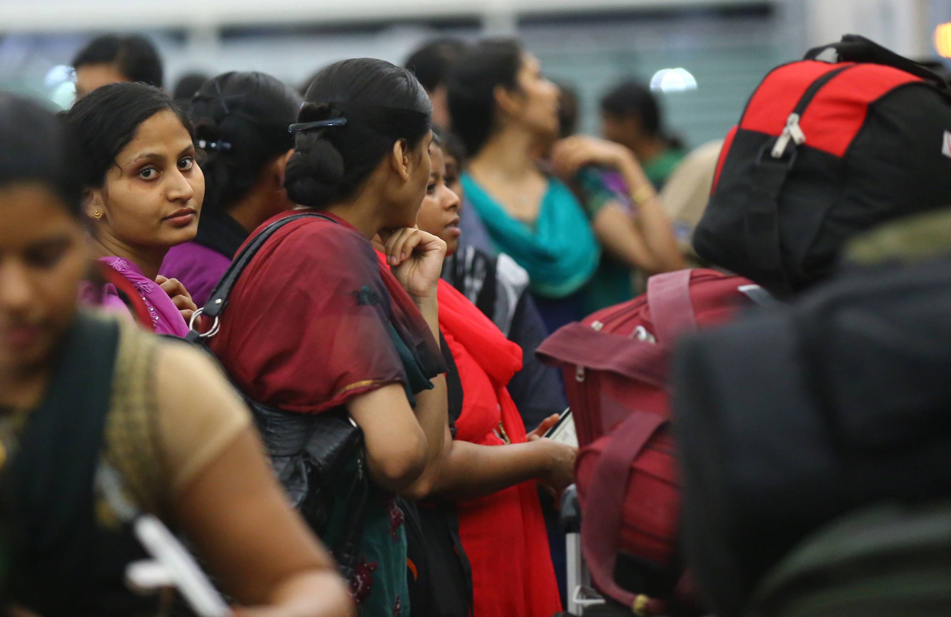 Indian nurses who were trapped in territory captured by Islamic militants wait for the plane Friday to begin their journey home.