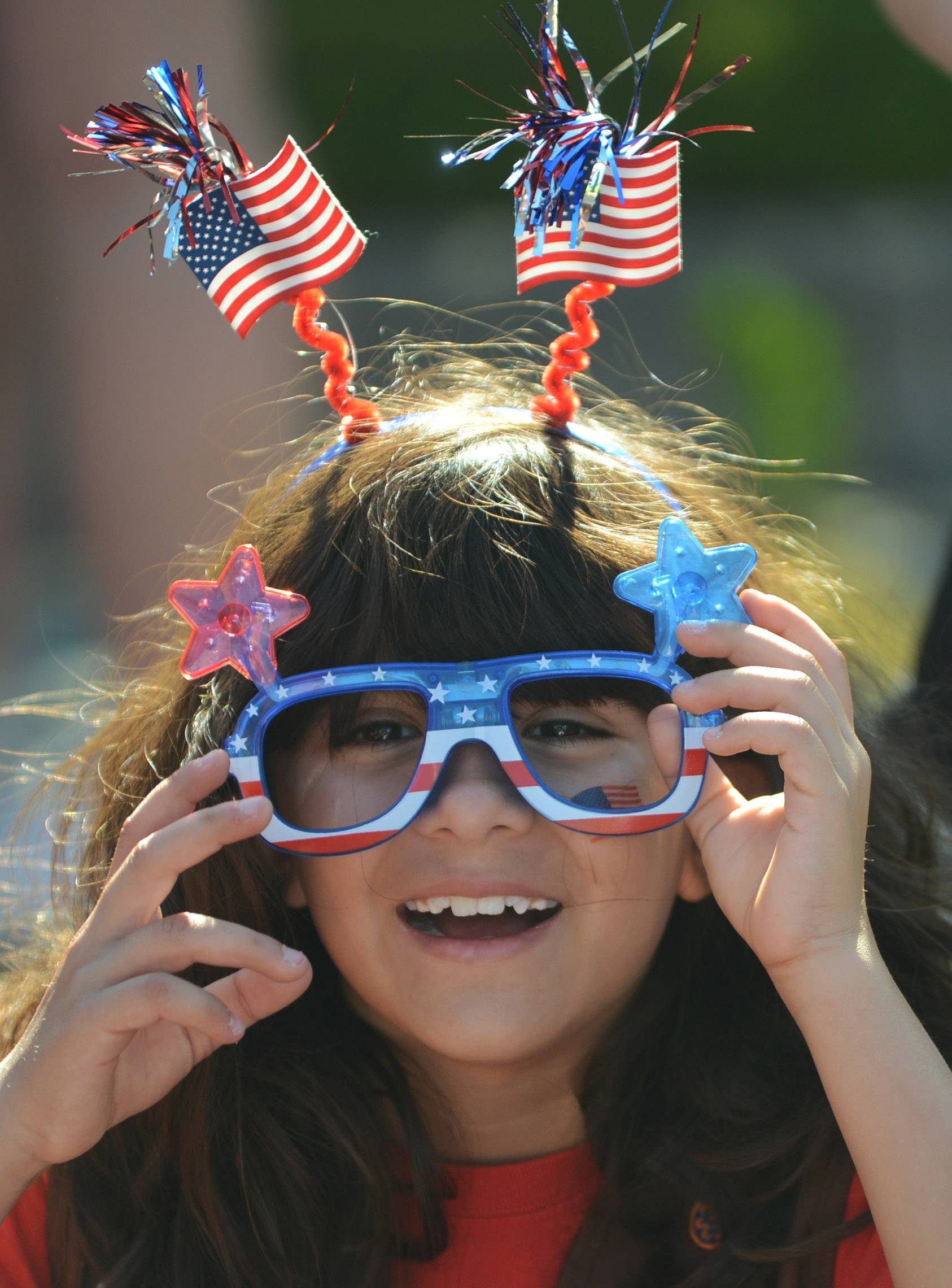 Carrie Adams, 8, of Mundelein, celebrates the Fourth of July in style Friday in Vernon Hills.