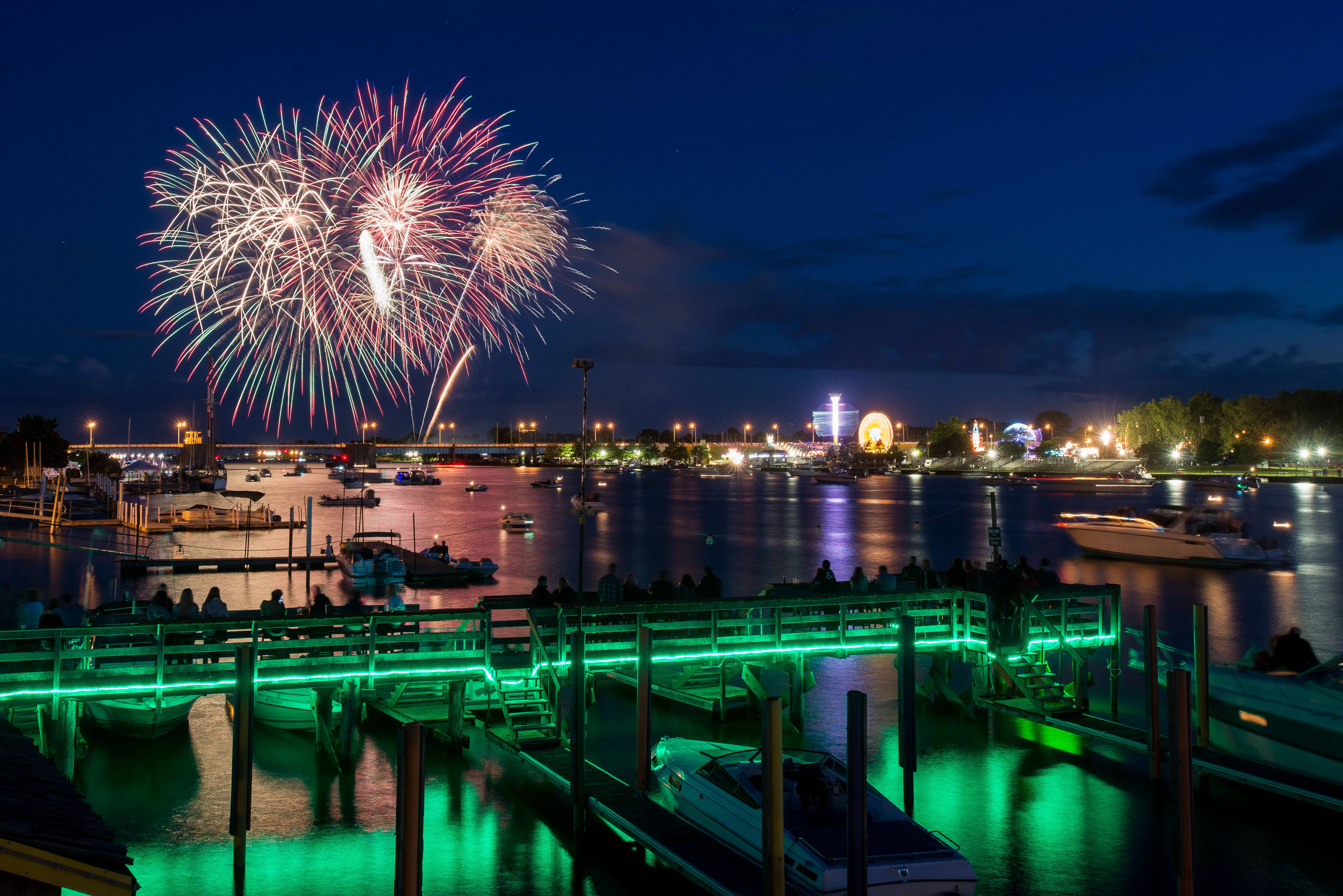 Fireworks light up the sky for the Firework Festival during the fireworks display on Thursday, July 3, 2014, over the Saginaw River in downtown Bay City. Mich.