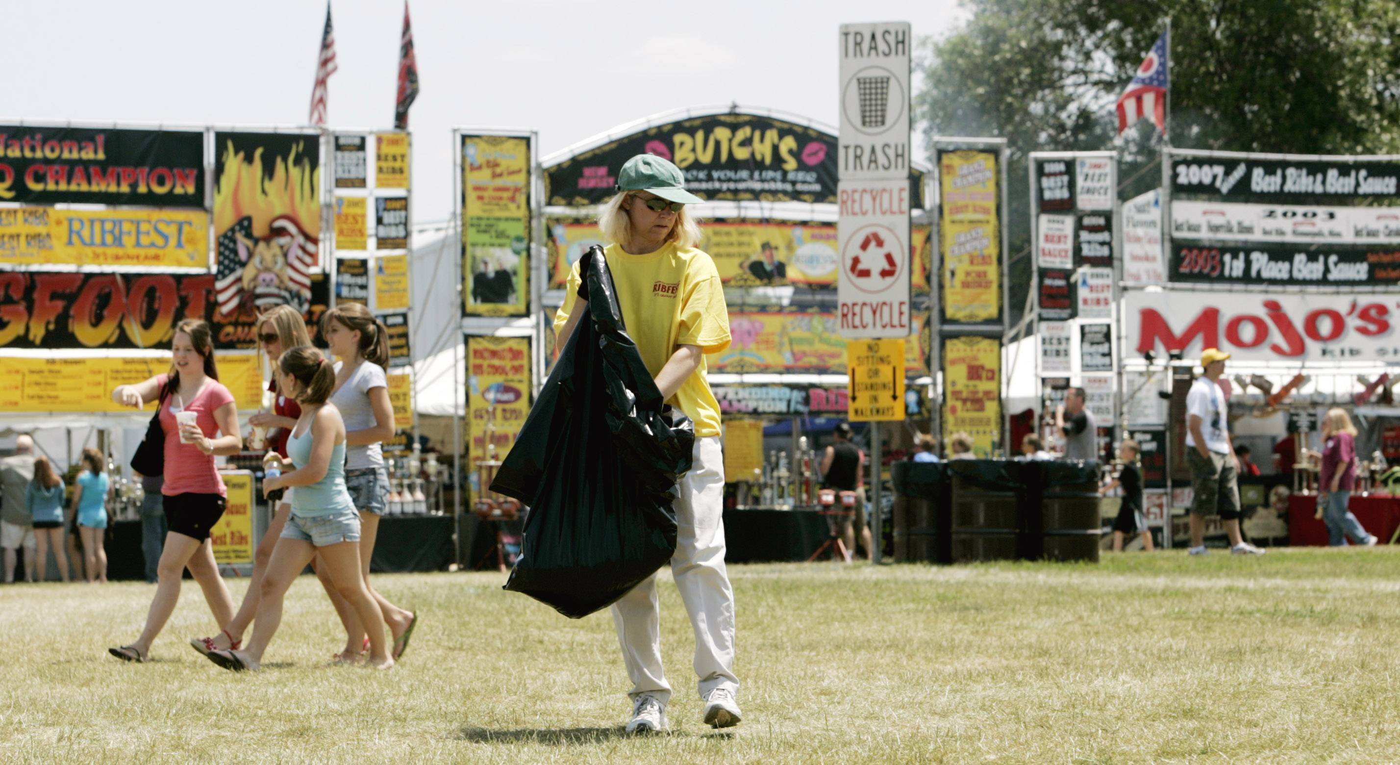 Picking up trash is a common job for many of the 4,000 volunteers Ribfest organizers need to keep the fest running smoothly each year.