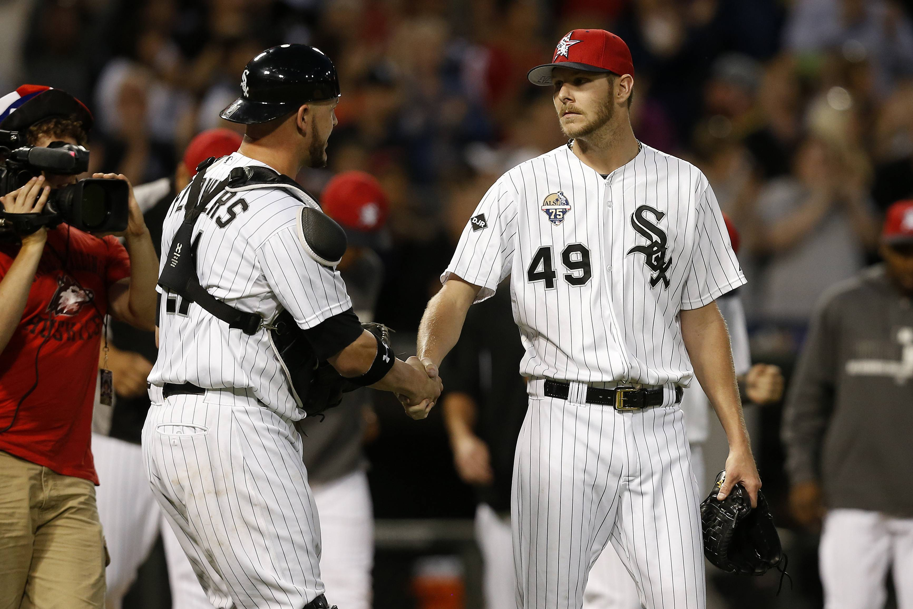 Chicago White Sox catcher Tyler Flowers, left, and starting pitcher Chris Sale, right, celebrate their 7-1 victory against the Seattle Mariners during the ninth inning of a baseball game on Friday, July 4, 2014, in Chicago.