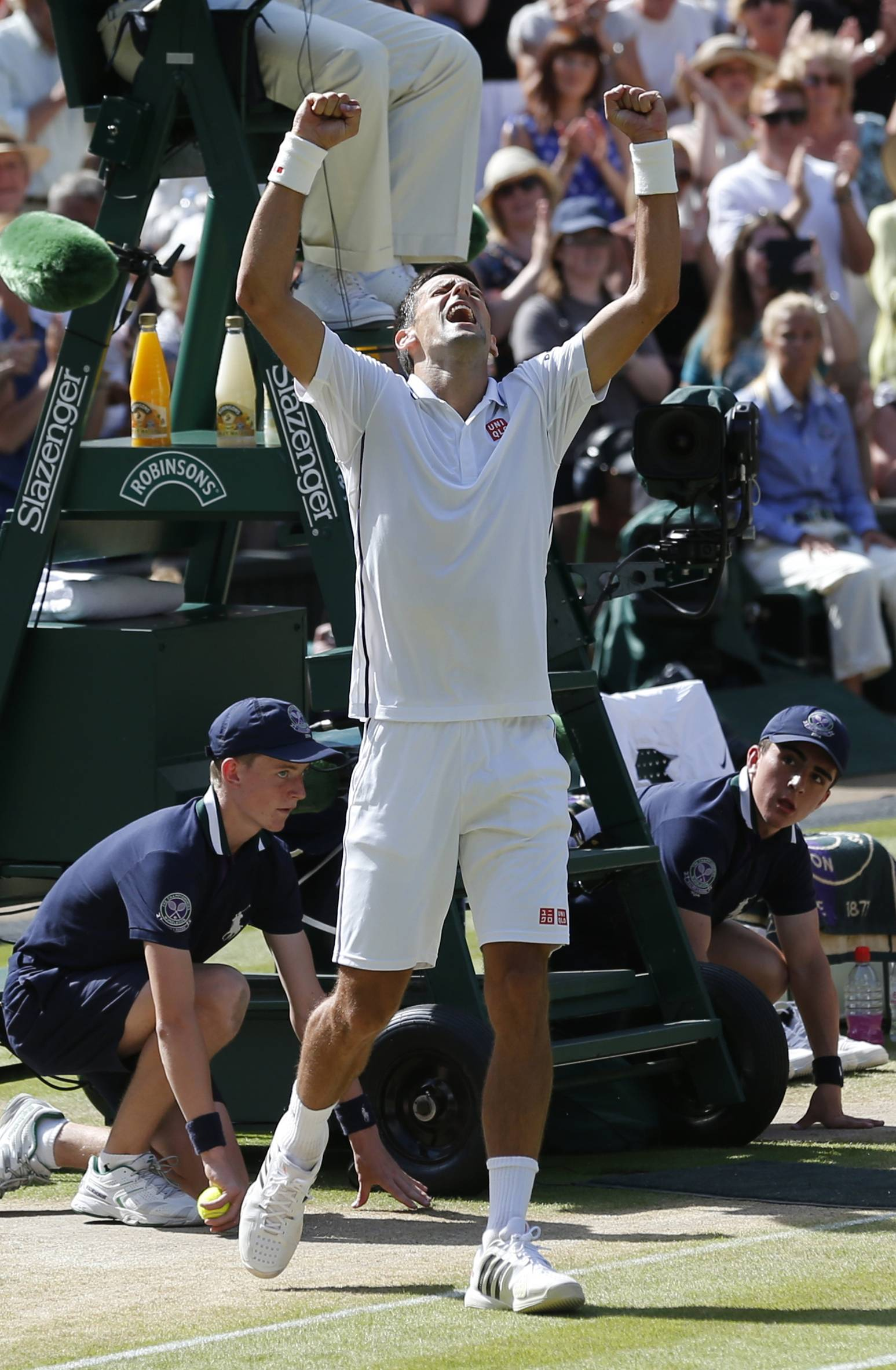 Novak Djokovic celebrates defeating Grigor Dimitrov in their men's semifinal match Friday at Wimbledon.