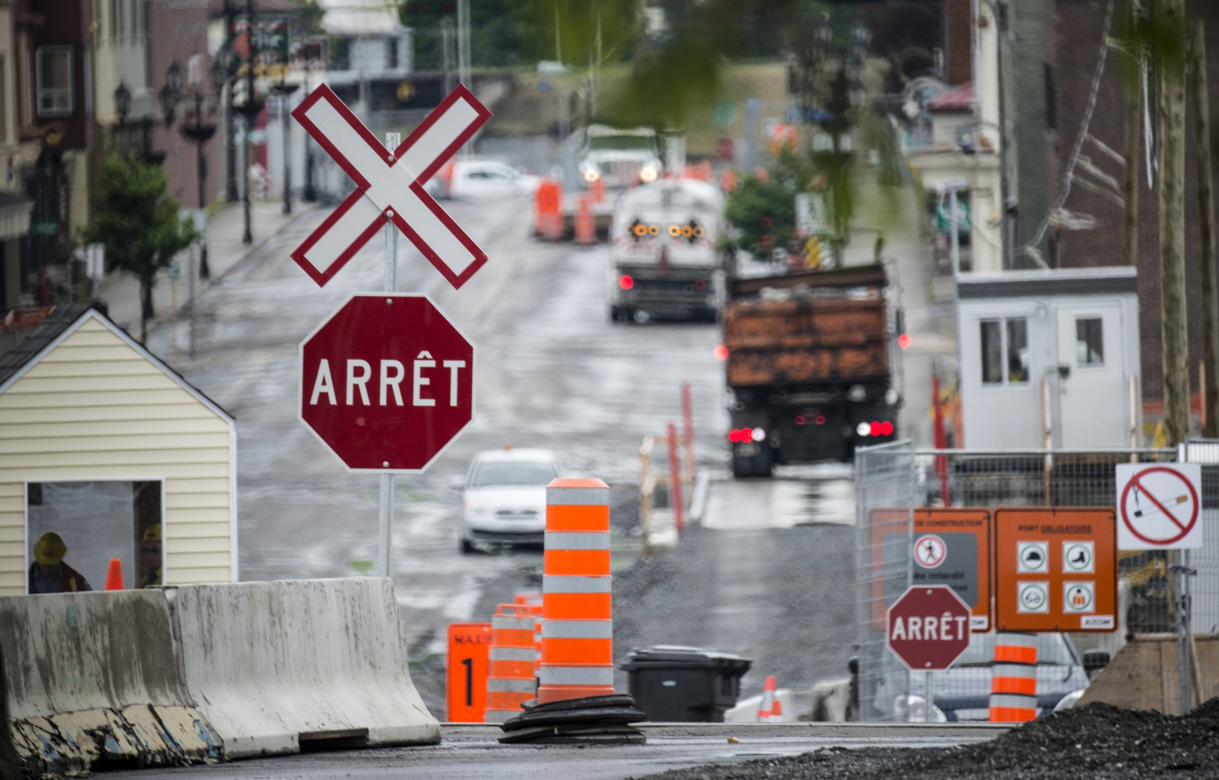 The downtown of Lac-Megantic, Quebec, remains closed June 10, 2014, as crews work at the clearing and decontamination a year after an oil-filled train screeched off the tracks and exploded killing 47 people.