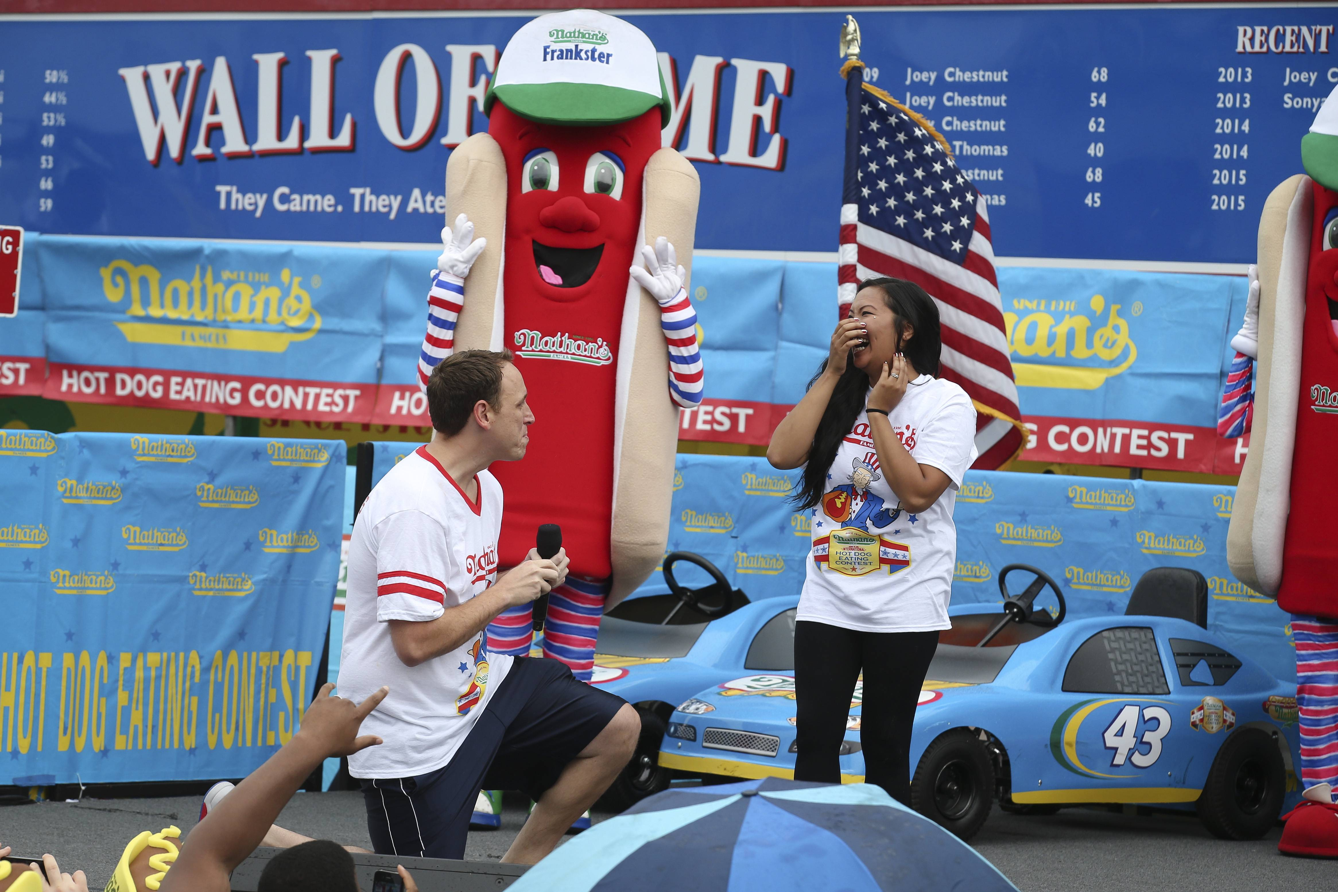 Competitive eater Joey Chestnut proposes to his girlfriend and fellow competitor Neslie Ricasa before the Nathan's Famous Fourth of July International Hot Dog Eating contest.