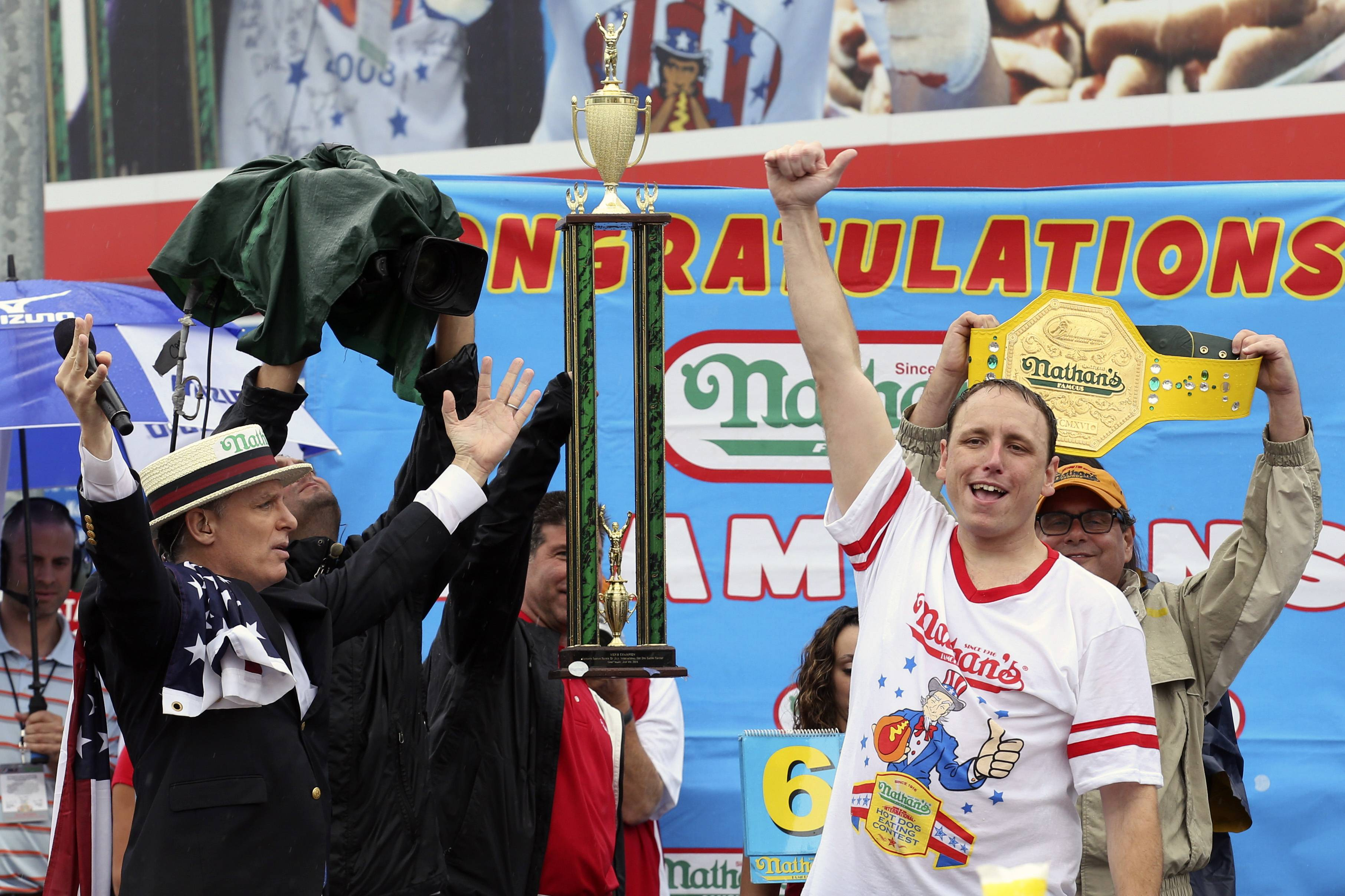 Joey Chestnut raises his fist in the air after winning Nathan's Famous Fourth of July International Hot Dog Eating contest Friday at Coney Island.
