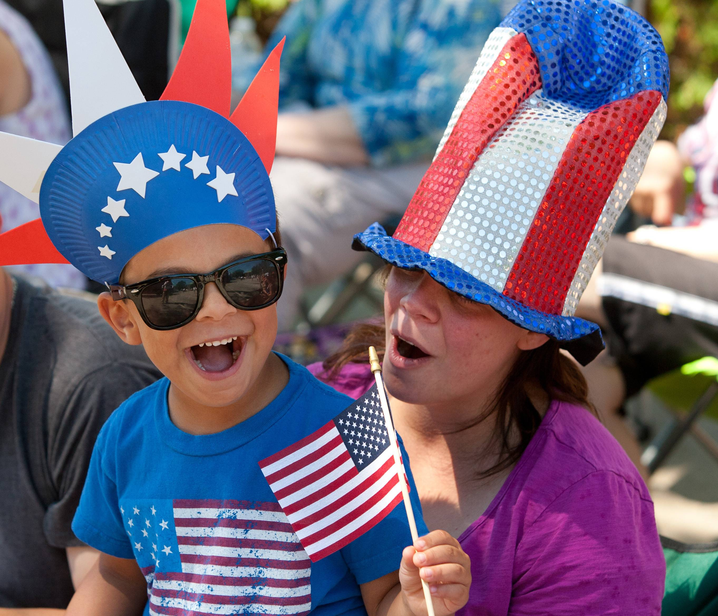 Nicholas Principe, 4, and his mother, Melissa Principe of Wheaton, watch their hometown Independence Day parade.