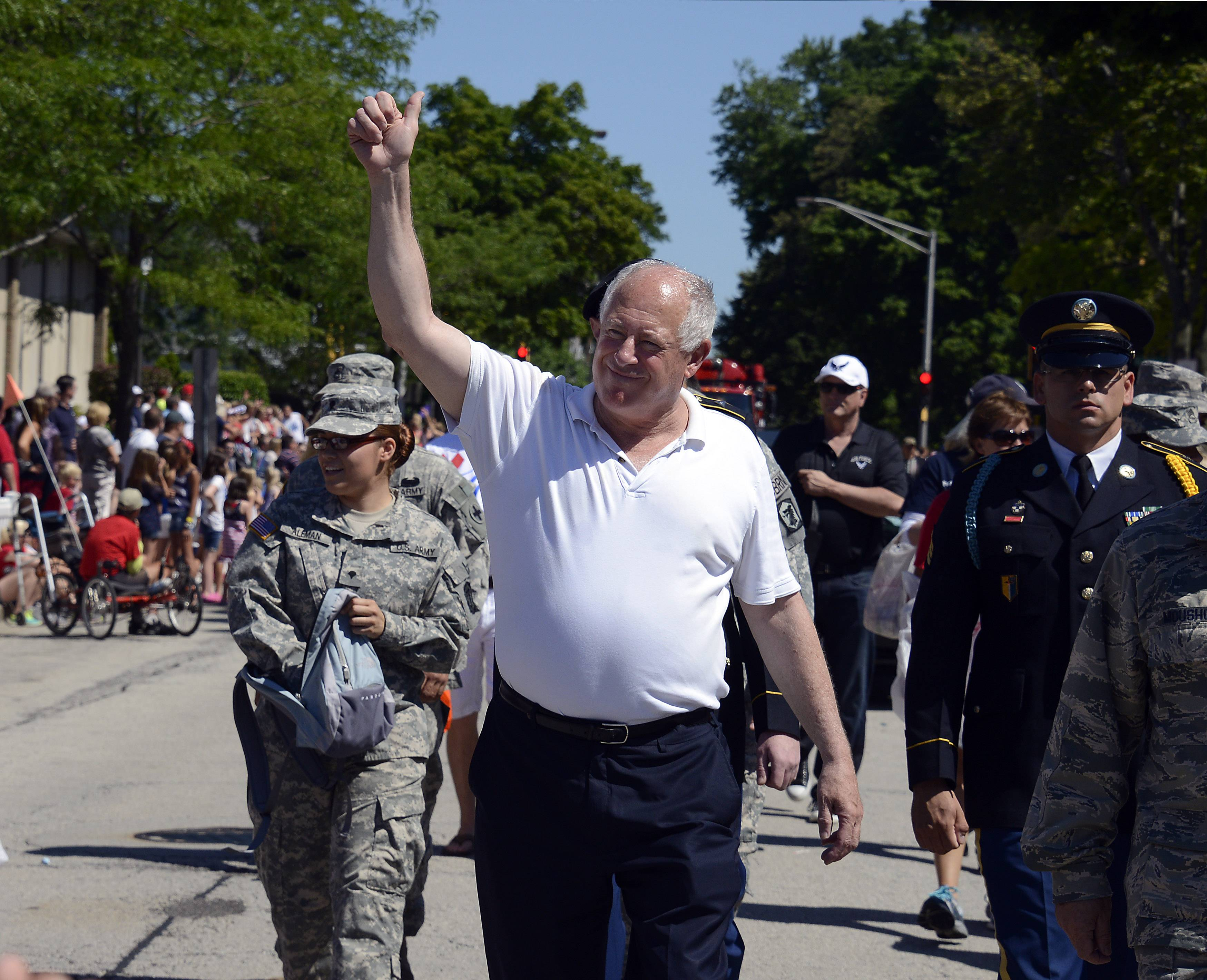 Illinois Governor Pat Quinn walks in the Arlington Heights 4th of July parade on Friday.