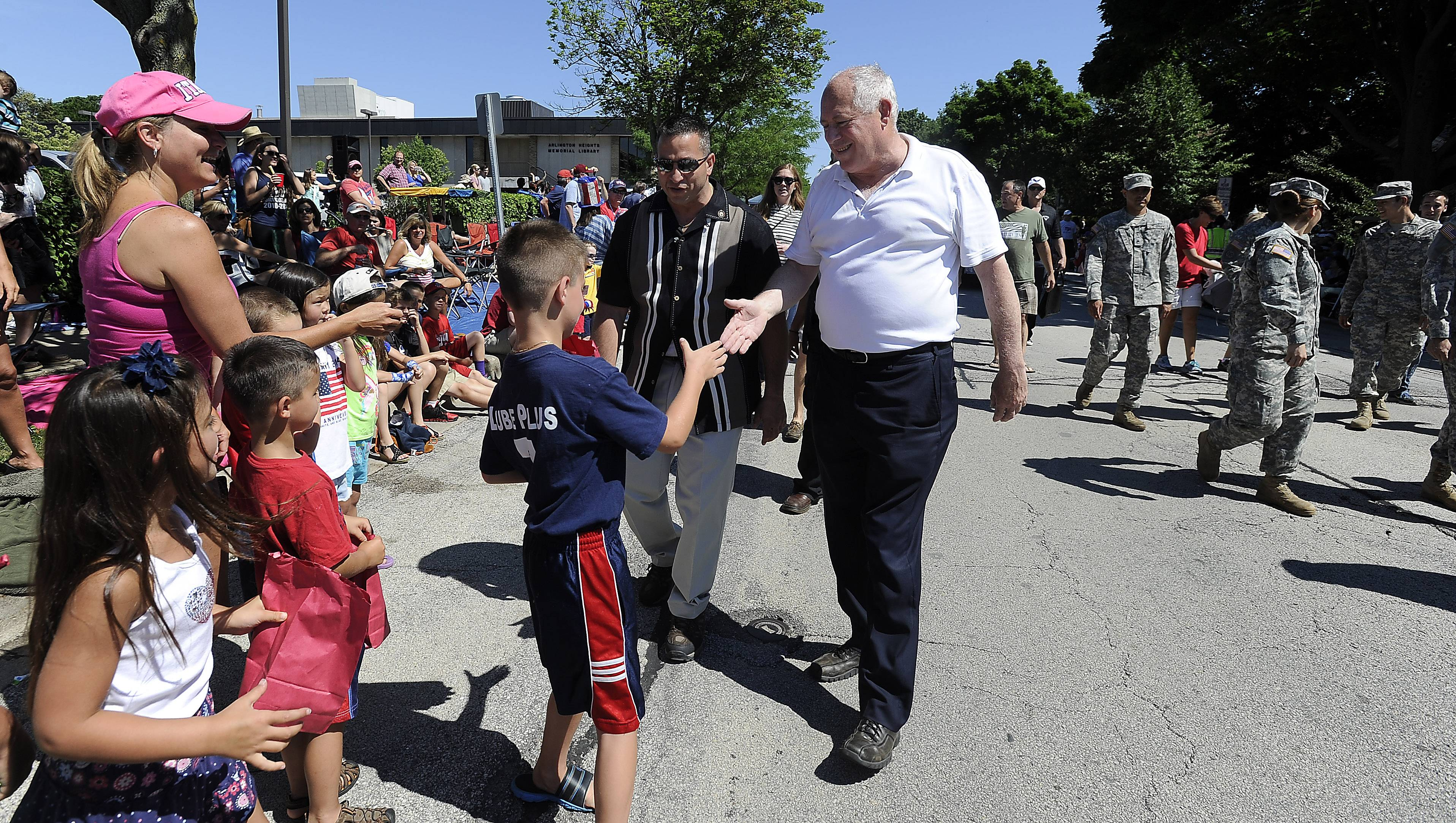 Illinois Governor Pat Quinn greets the people along the parade route of the Arlington Heights 4th of July parade on Friday.