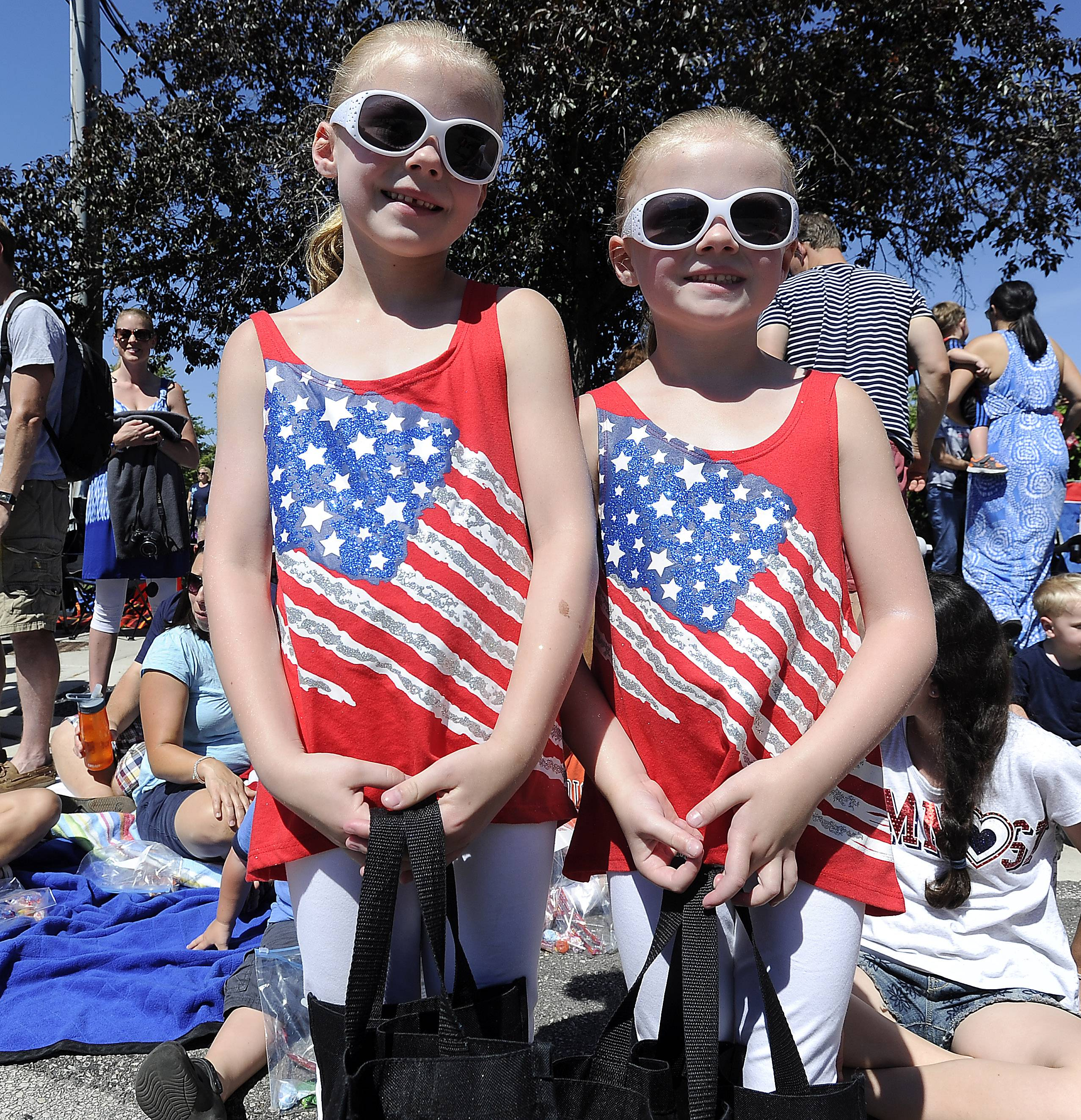 Mackenzie, 7, and Makayla Richards, 5, of Cary add a little color to the Arlington Heights 4th of July parade on Friday.