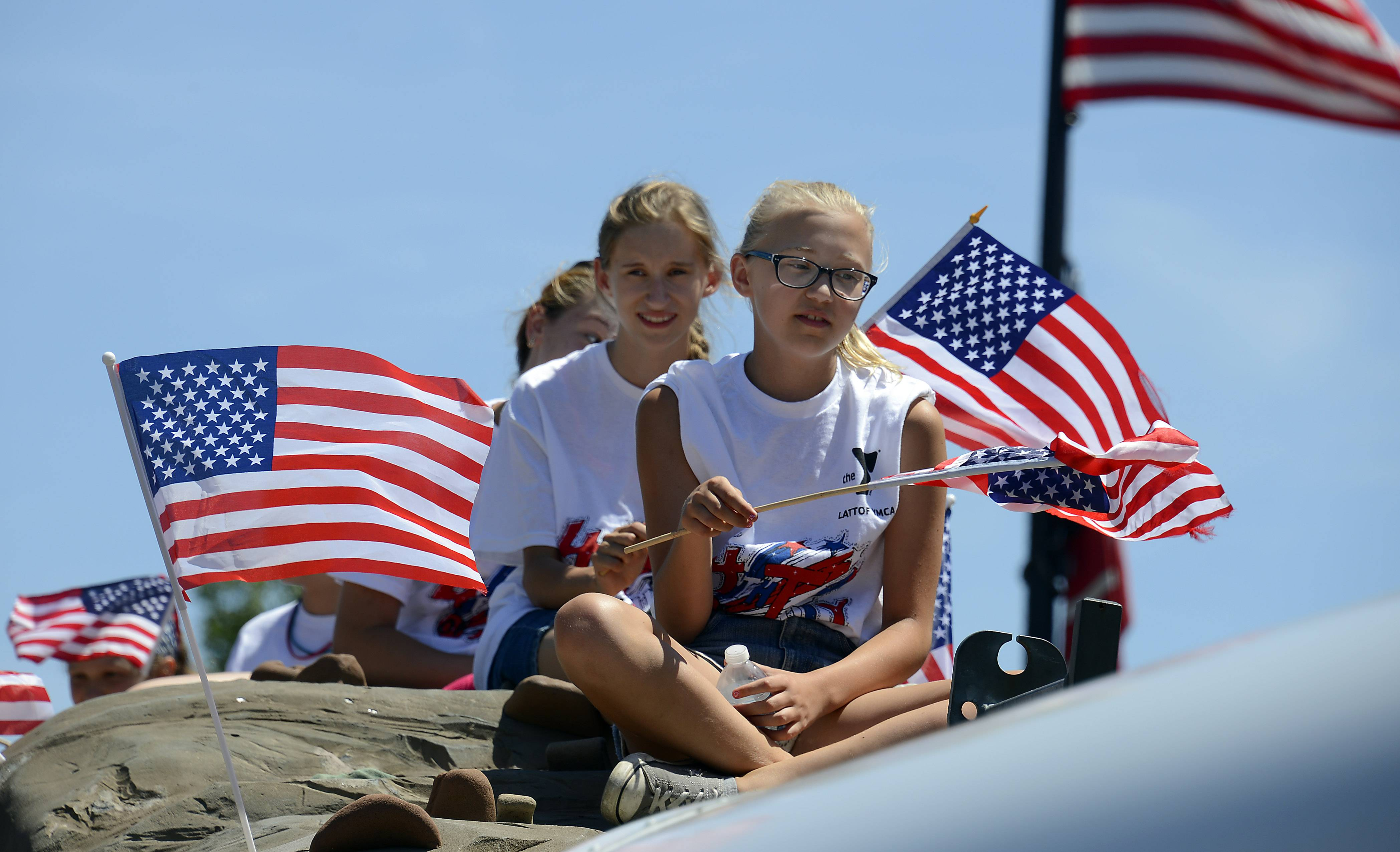 Marion Bensing, 12, of Arlington Heights rides the float for Lattof YMCA  during the Mount Prospect parade.