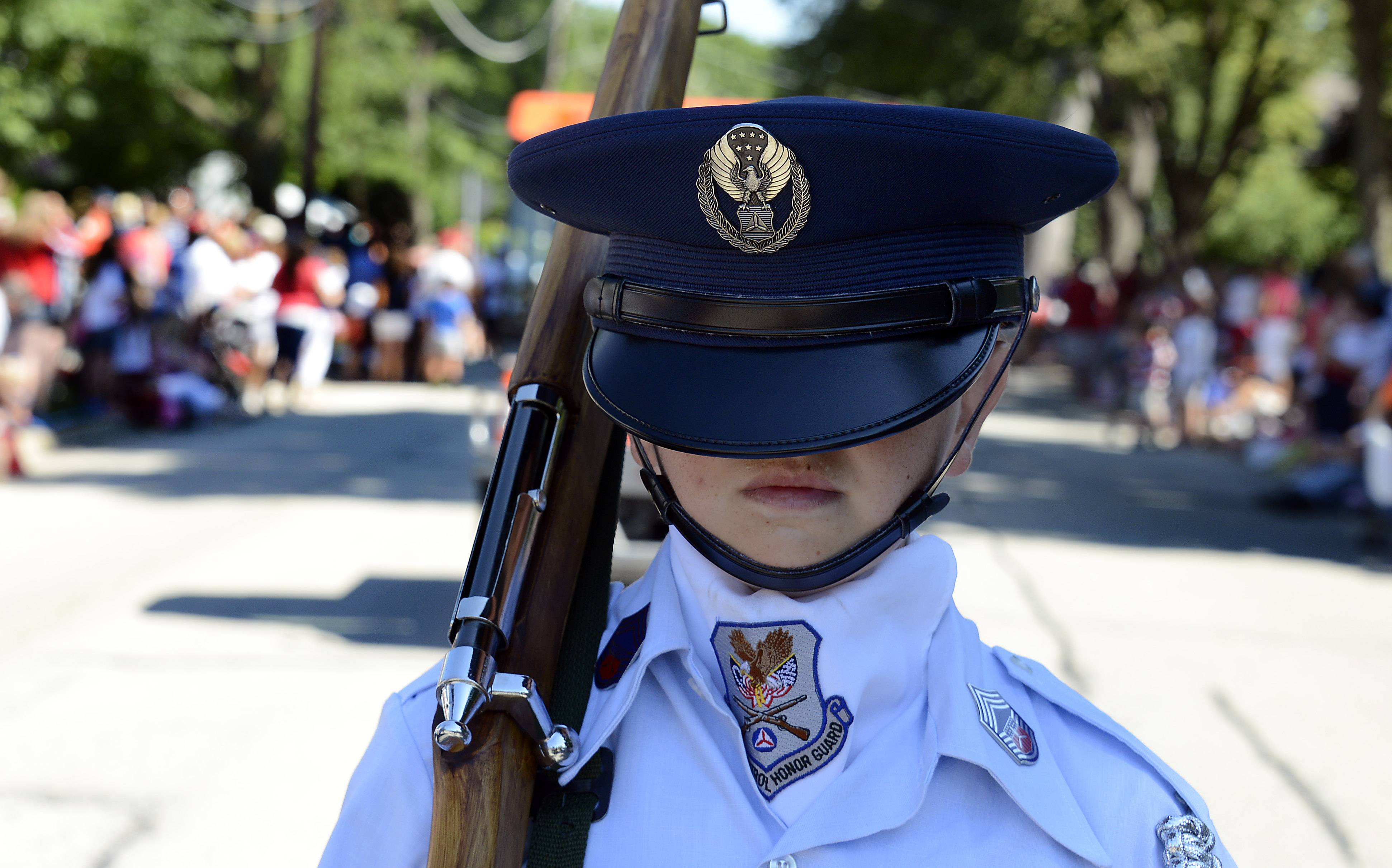 Benjamin Ptak, 14, of Sleepy Hollow marches in the Arlington Heights 4th of July parade as part of the Civil Air Patrol honor guard.