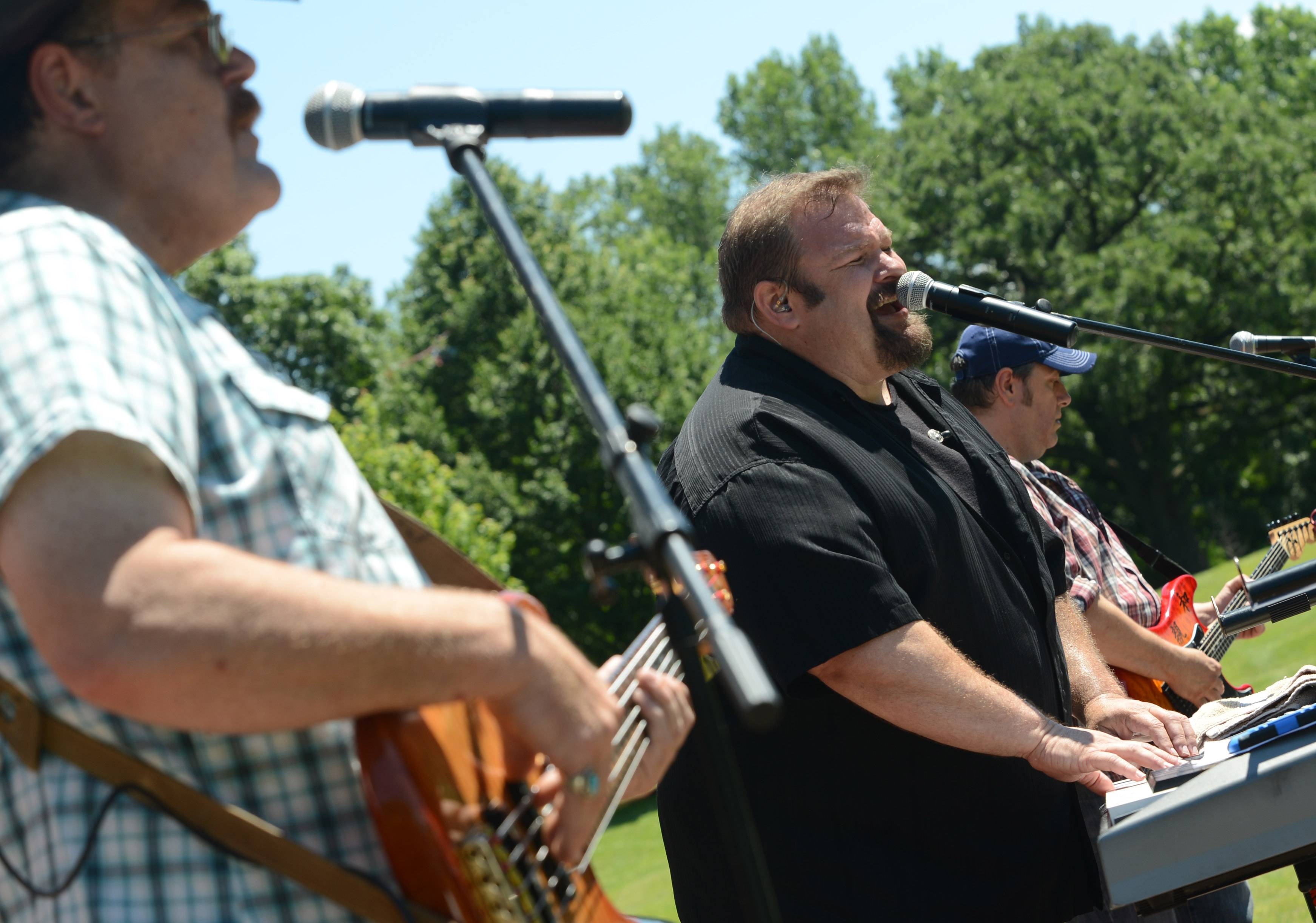 Members of Stateline County Band from left Dennis Myers, Robert Jess and Mark Villarreal perform at the Lake Zurich Fourth of July family day at Paulus Park.