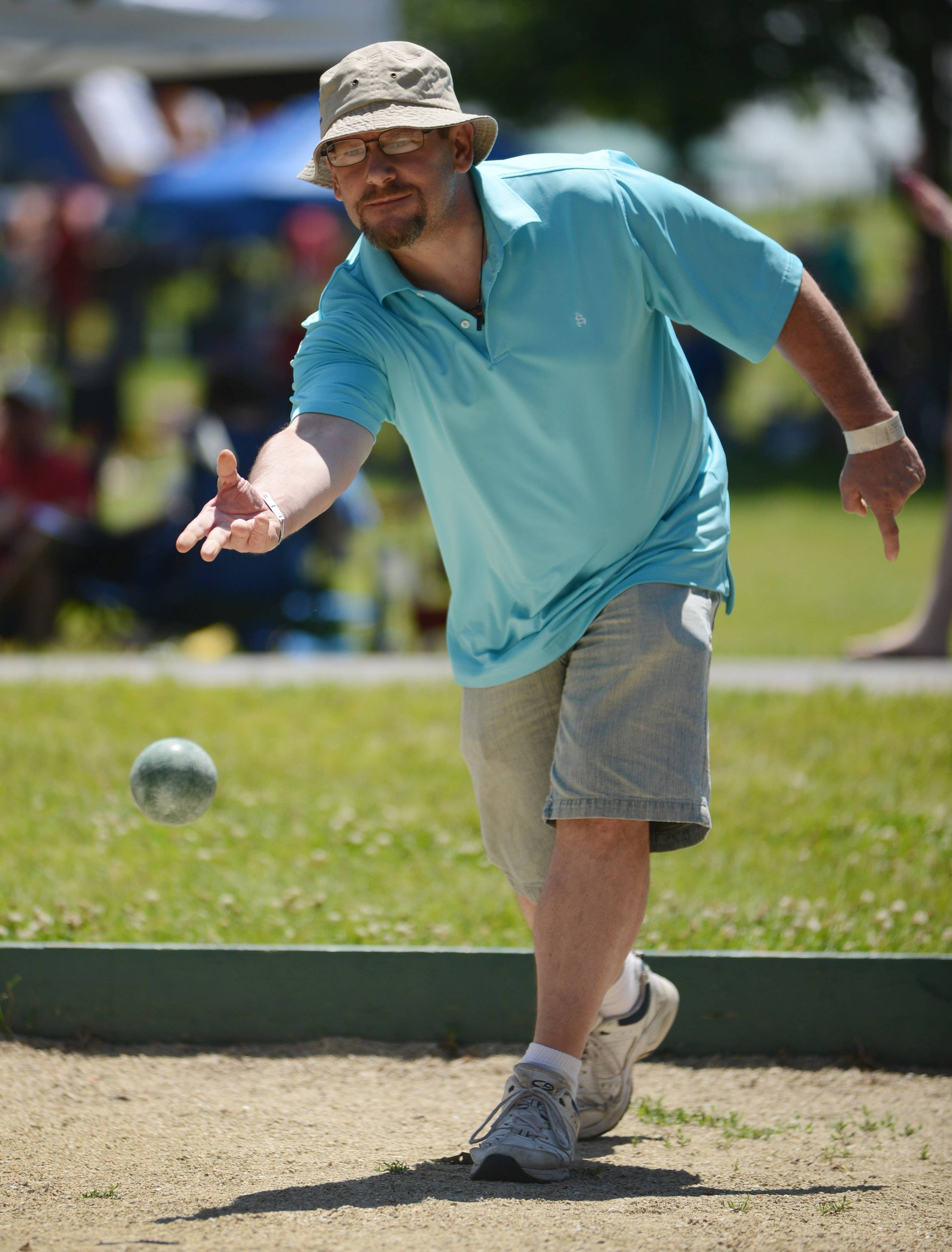 Veteran Shawn Bloomer of North Chicago plays bocce ball during the Lake Zurich Fourth of July family day in Paulus Park on Friday.