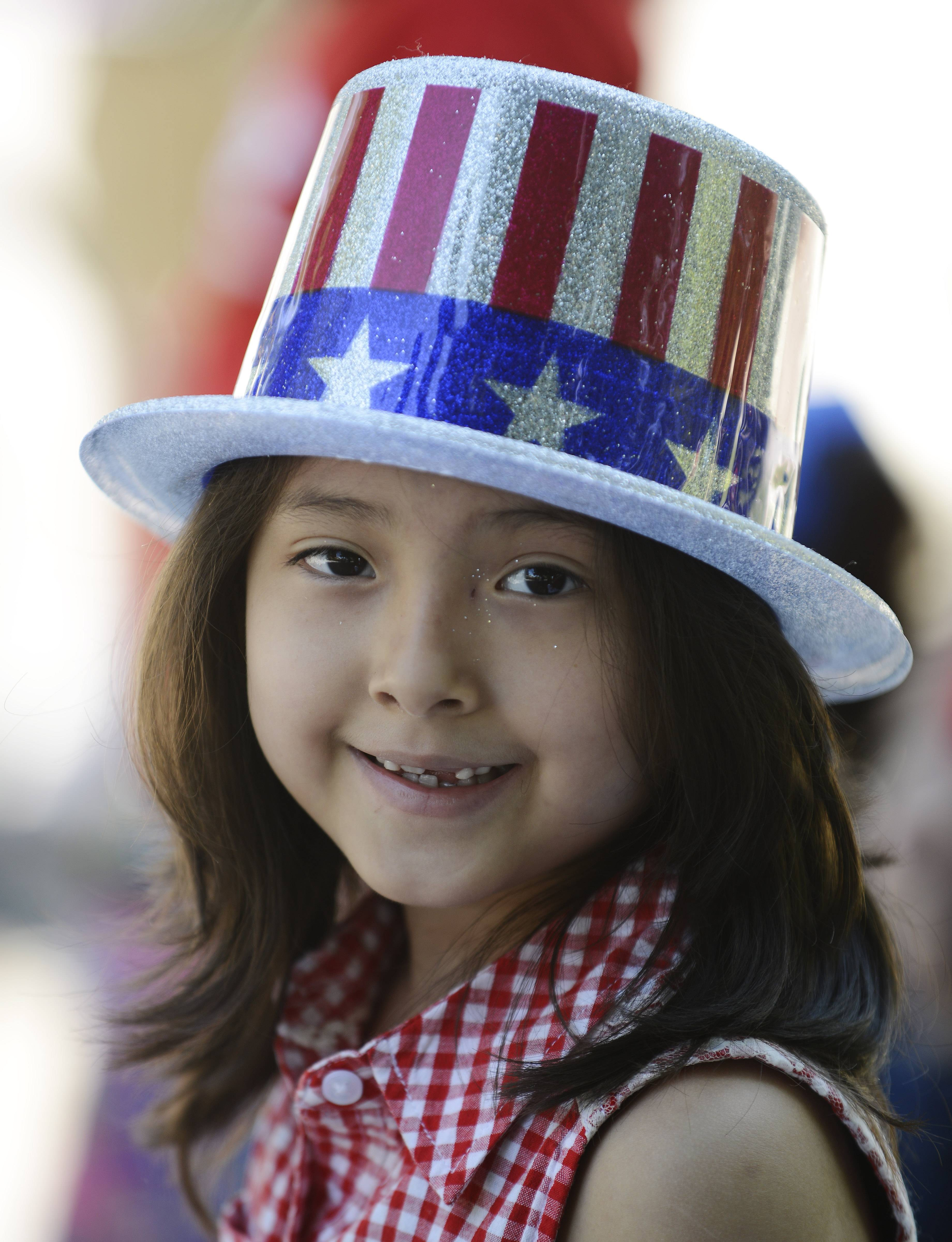 Ely Barrientos, 7, of Rolling Meadows awaits the start of the Rolling Meadows Fourth of July parade Friday.