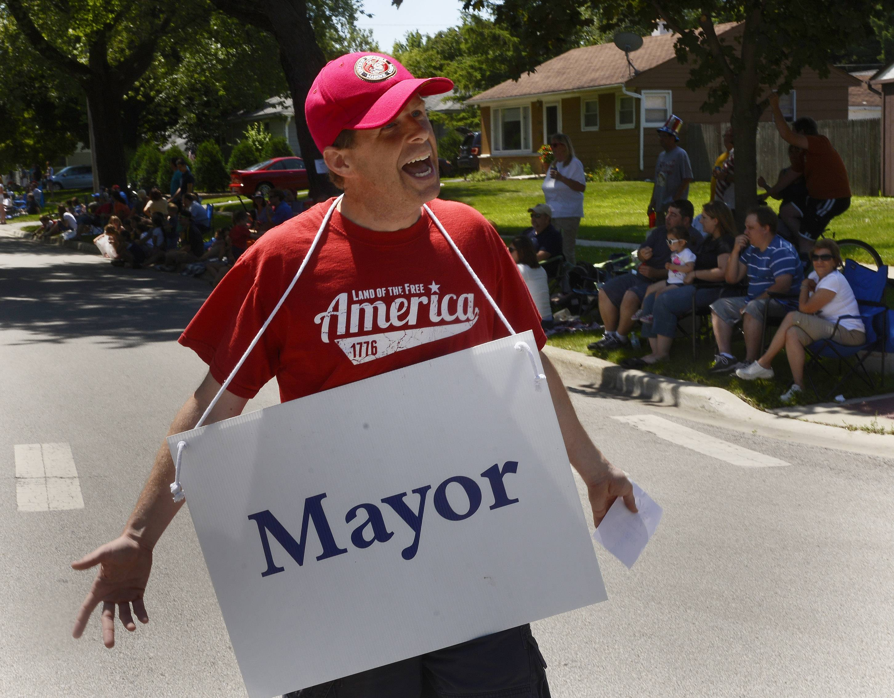 Rolling Meadows Mayor Tom Rooney leaves no one wondering what office he holds as he marches in the Rolling Meadows Fourth of July parade Friday.