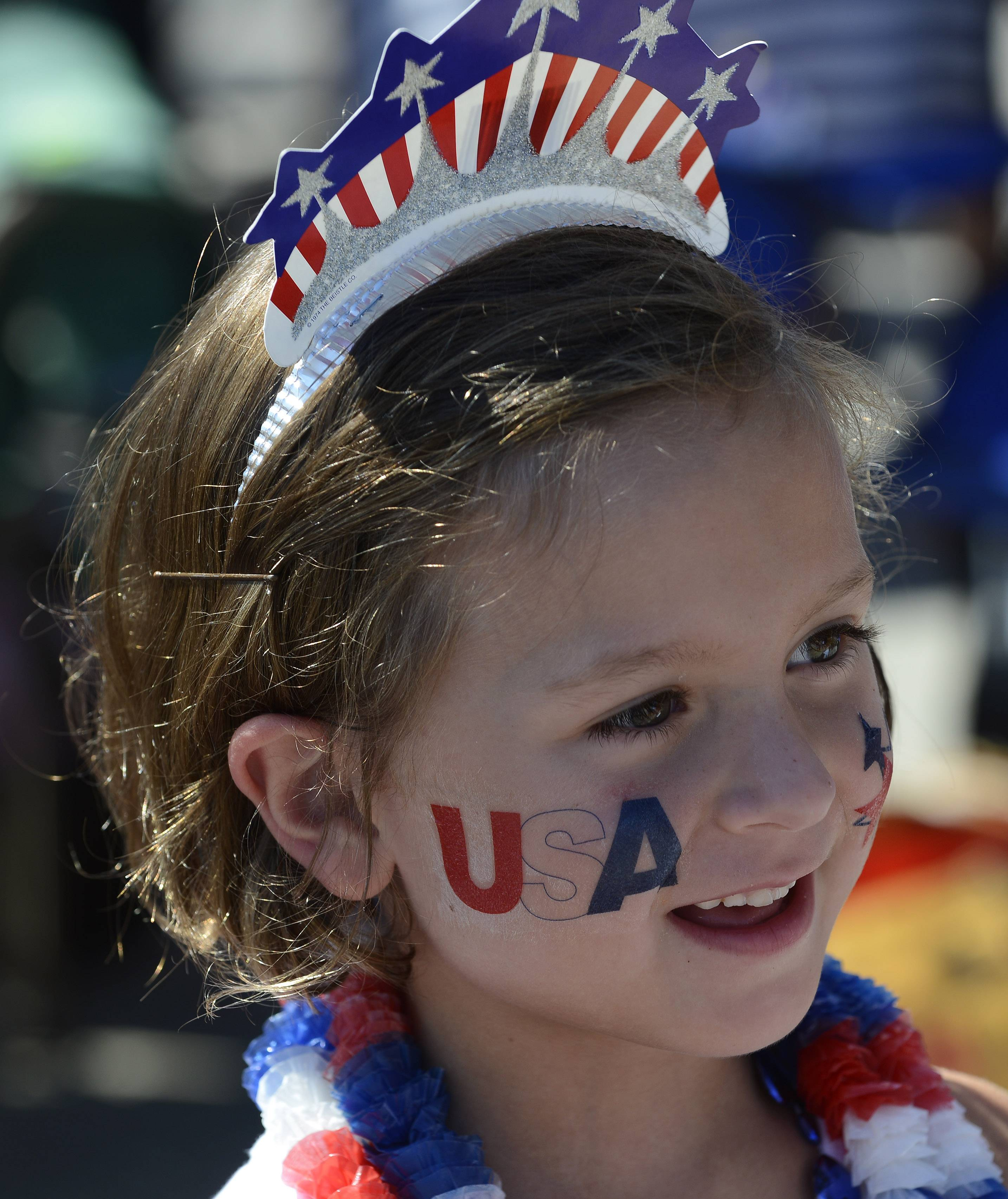 Rainey Roy, 6, of Barrington watches the Barrington Fourth of July parade Friday.