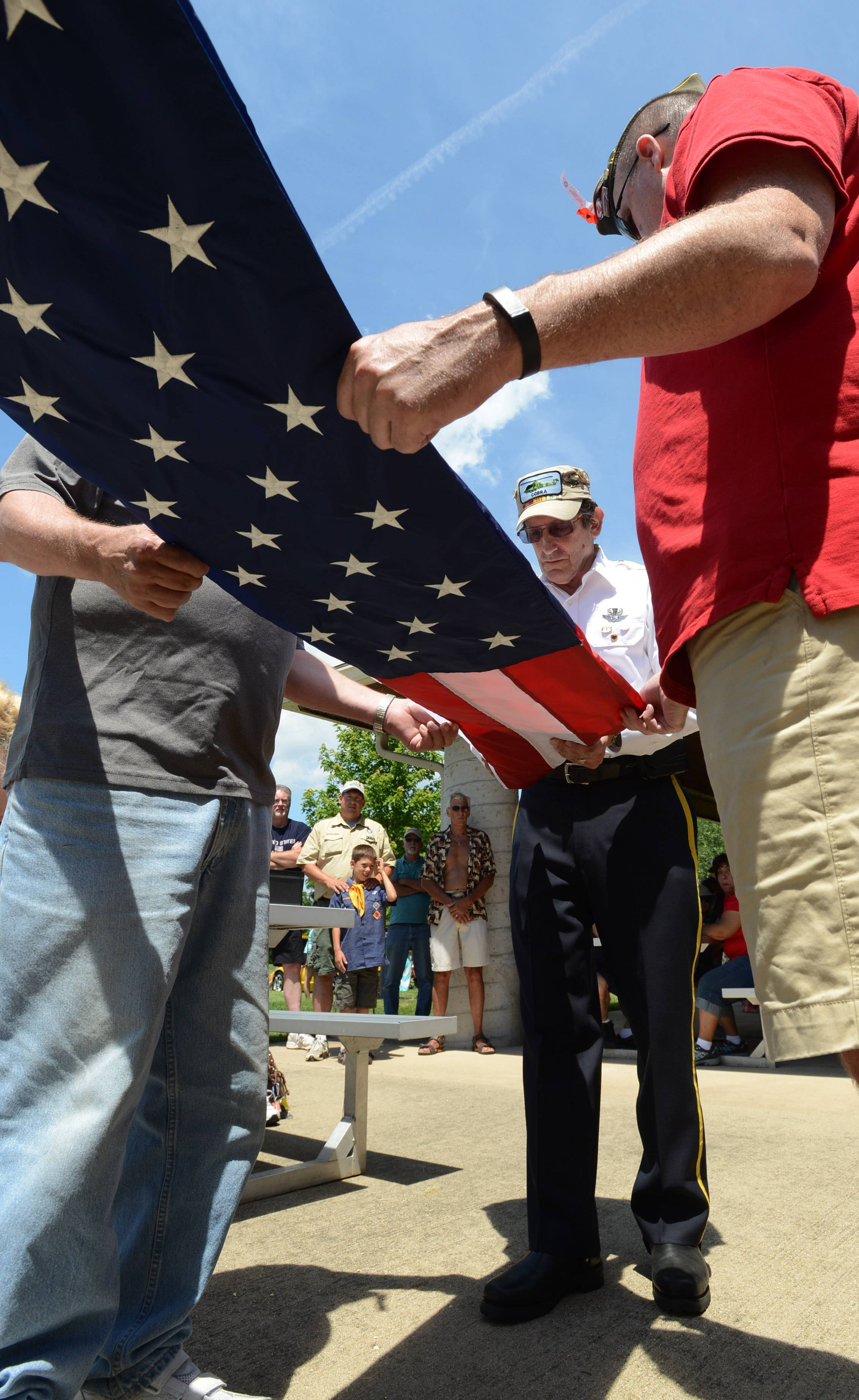 Wauconda's Barry Desfor is a member of the American Legion Post 911 and the VFW Post 2486 and participates in a flag folding demonstration during Island Lake's town picnic on the Fourth of July.