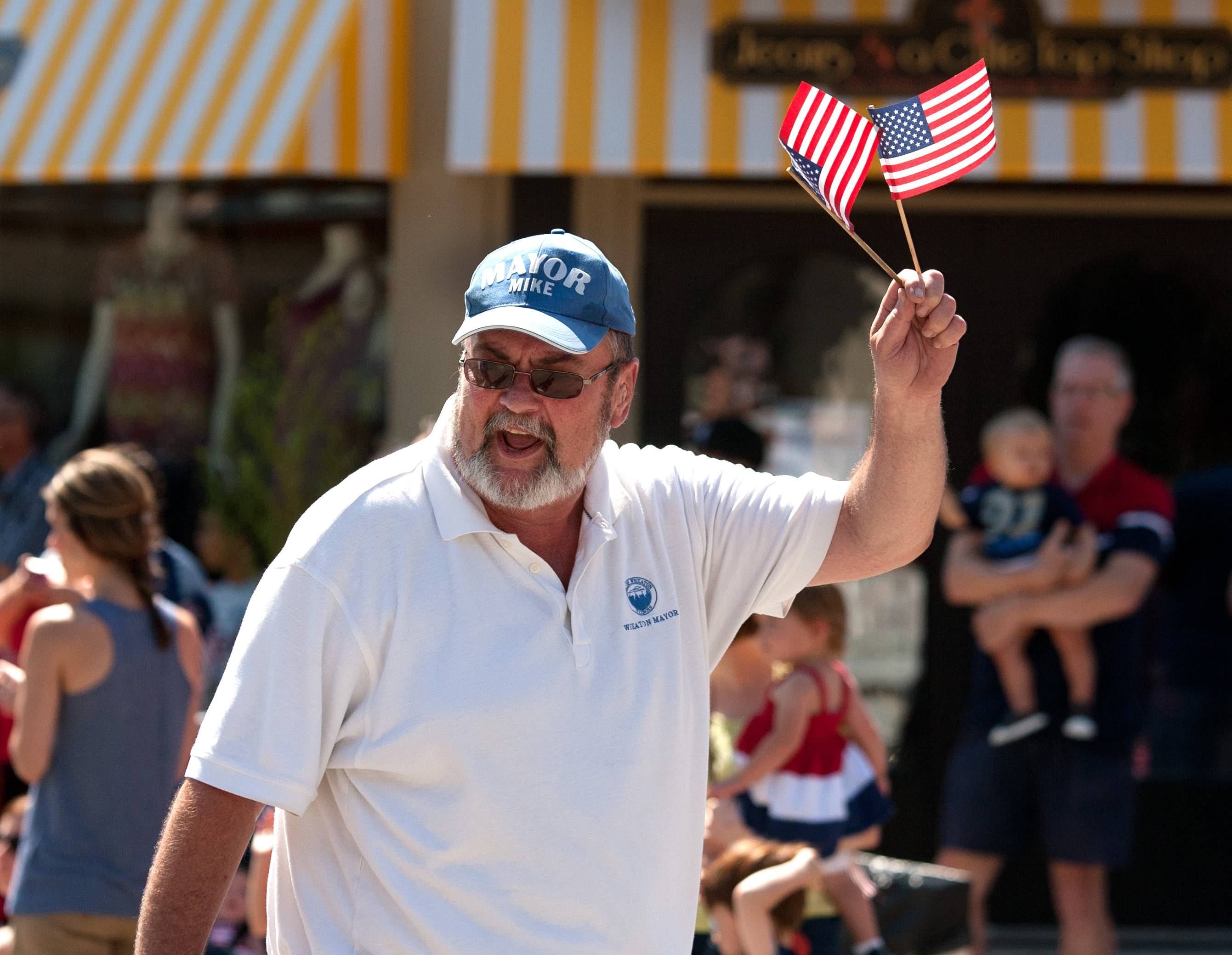 Wheaton Mayor Michael Gresk marches in Wheaton's 2014 Independence Day parade.