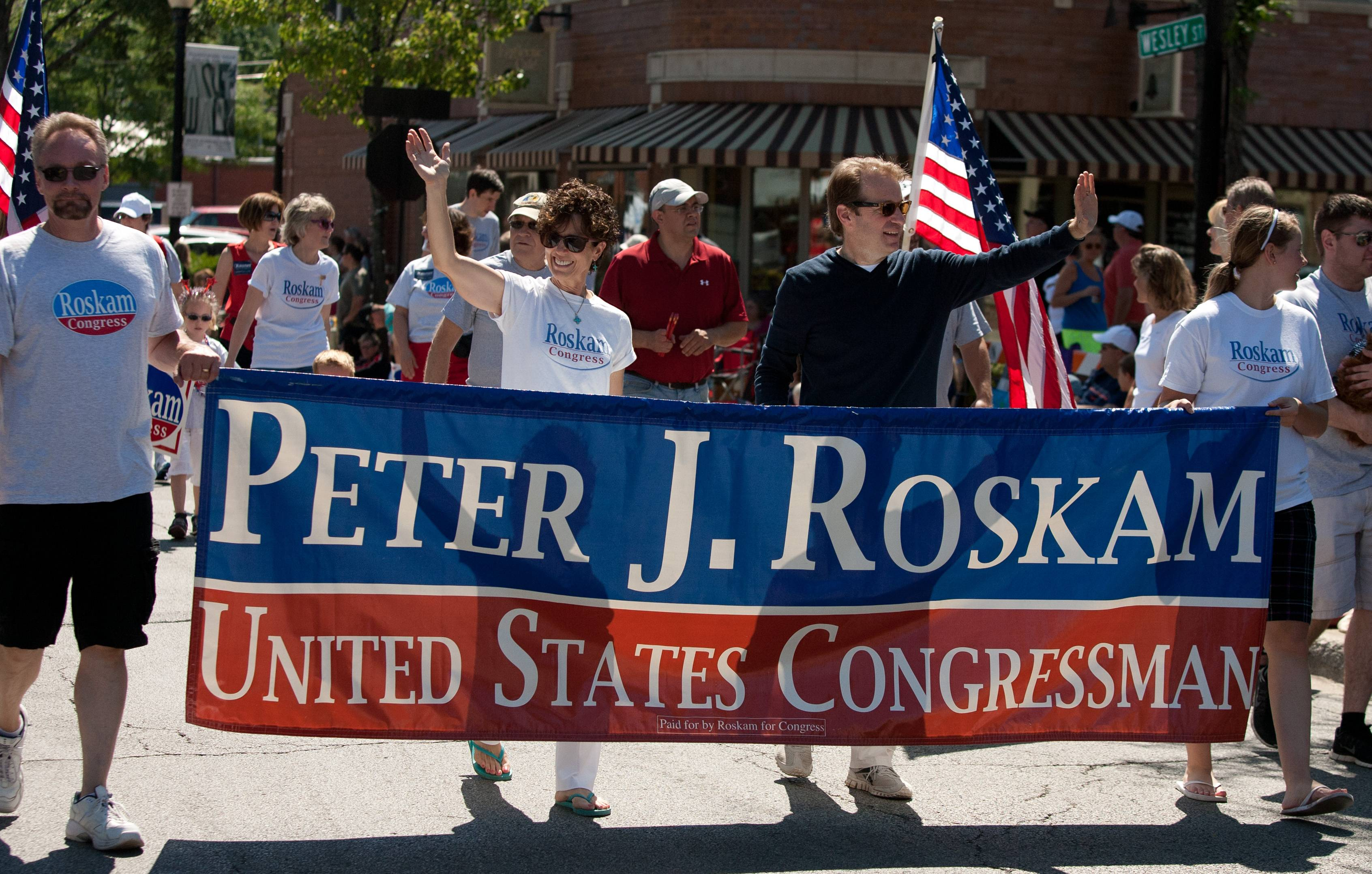 U.S. congressman Peter Roskam marches in Wheaton's 2014 Independence Day parade.