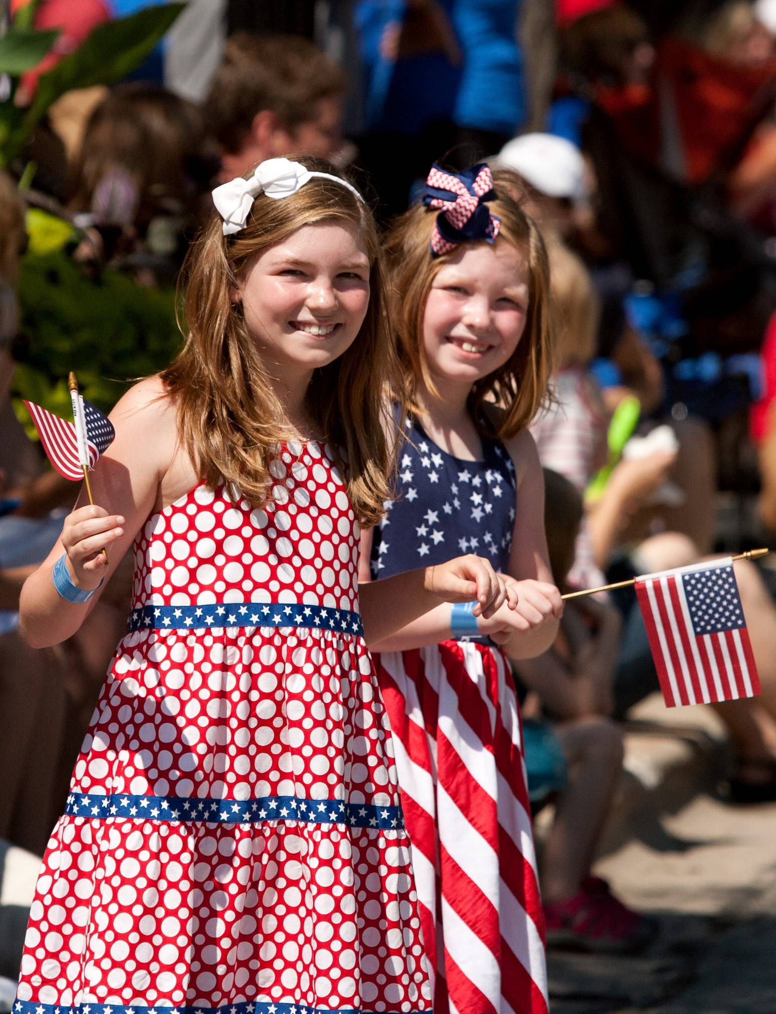 Former Wheaton residents Ella Pfeiffer, 9, and Aubrey Pfeiffer, 7, watch Wheaton's 2014 Independence Day parade.