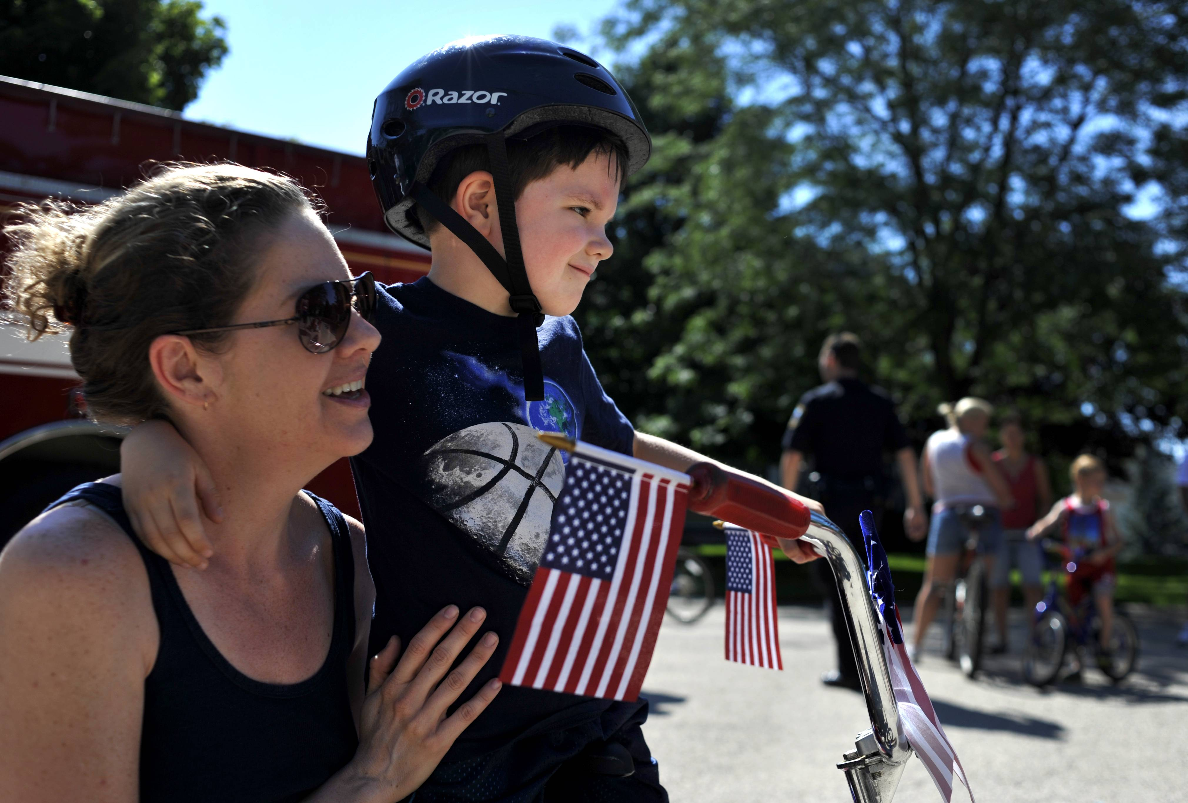 Ben Dawson, 5 of West Dundee receives encouragement from his mom, Katherine before the start of the Tartans/Hills neighborhood's annual Fourth of July kids' bike parade in West Dundee. The annual parade began in 1991 and is organized by the neighborhood, with Tim and Elizabeth Ward heading the organization of the event for the past few years.