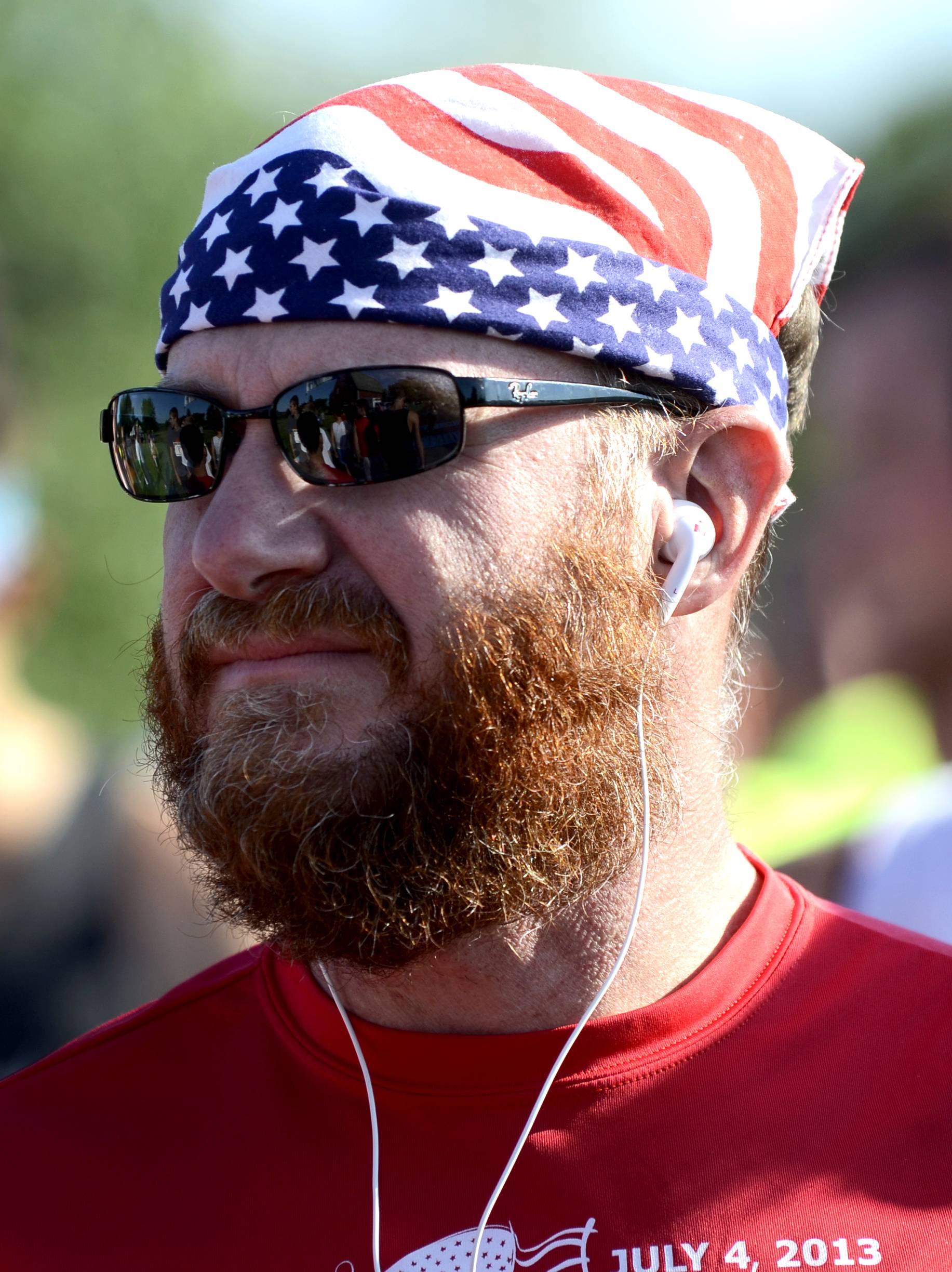 Robert Simmons of Lake in the Hills pauses for a moment before the start of the July Fourth Great Western Freedom 4 to benefit Lazarus House at the LeRoy Oakes Forest Preserve in St. Charles on Friday.