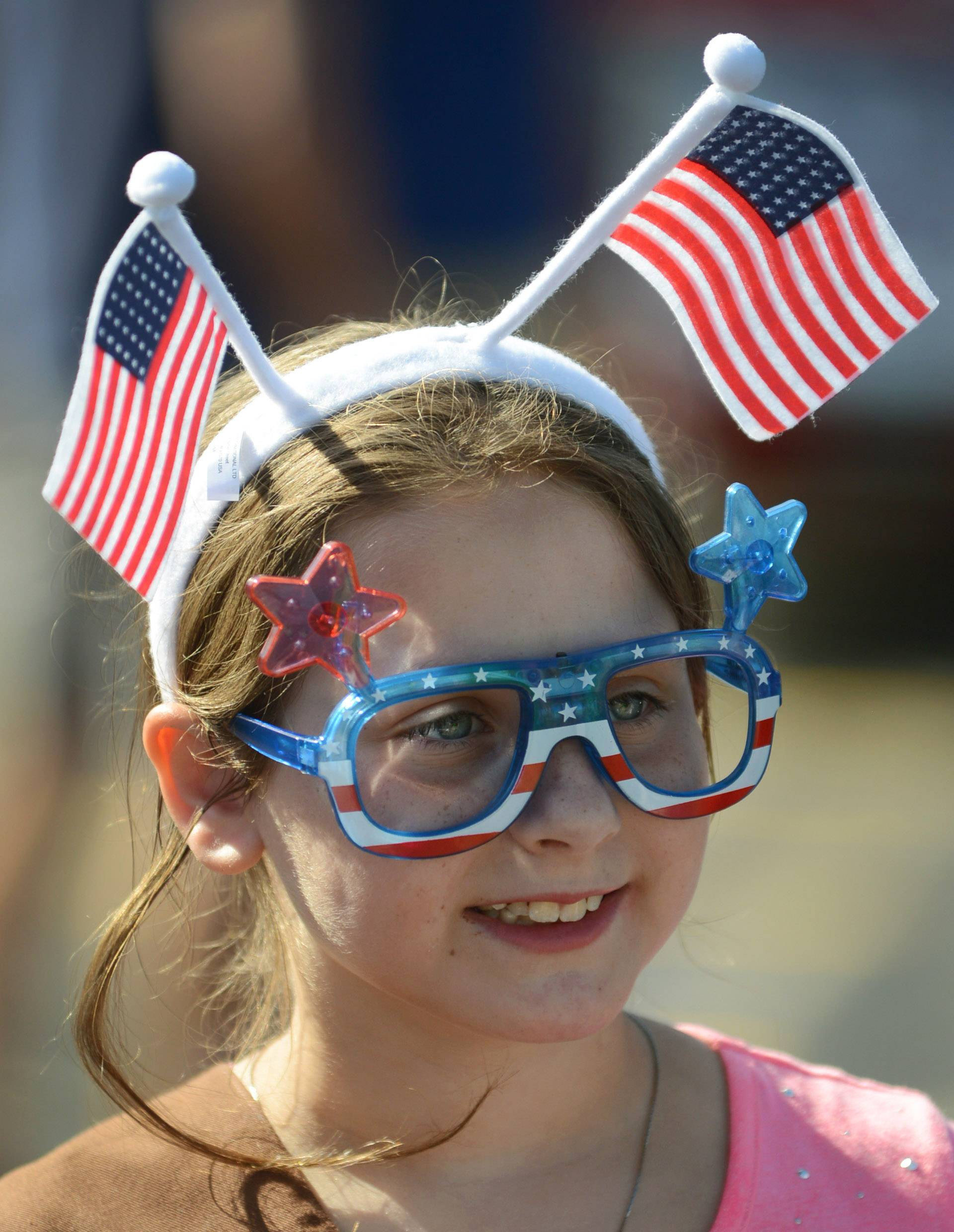 Margaret Zywick, 8 of Vernon Hills, is ready to march with her fellow Troop 40001 girls scouts in Friday's Vernon Hills Fourth of July parade.